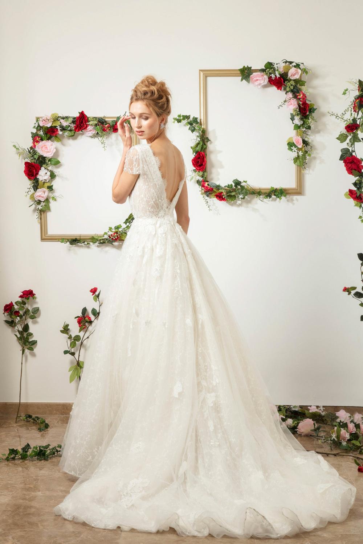 Low back dress by CCM Wedding