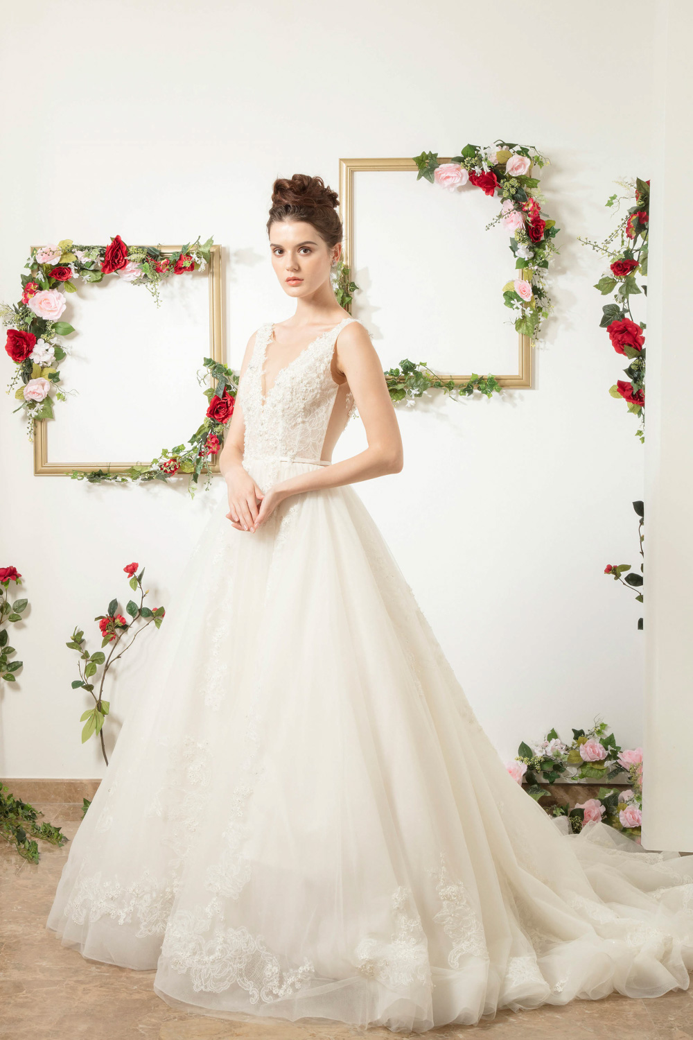 Wedding dress with illusion plunging neckline by CCM Wedding