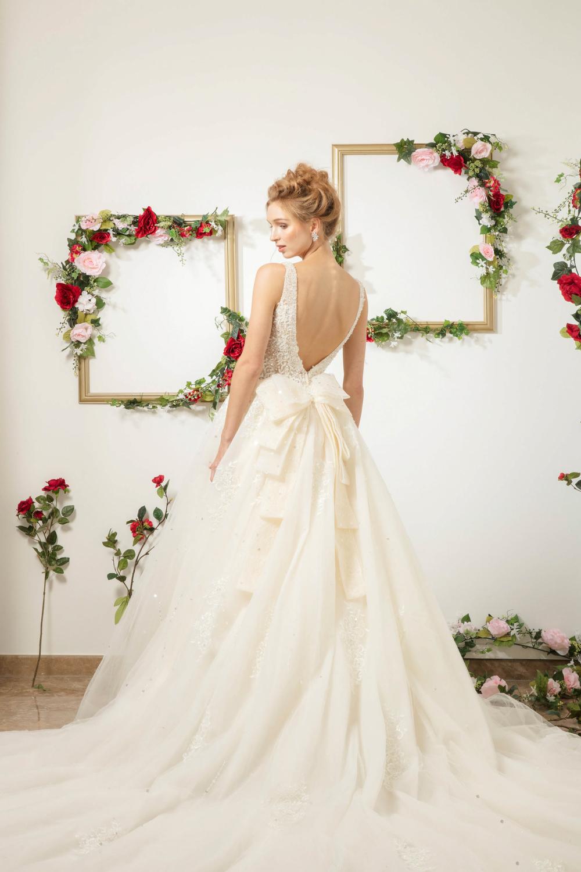 Wedding dress with bow by CCM Wedding