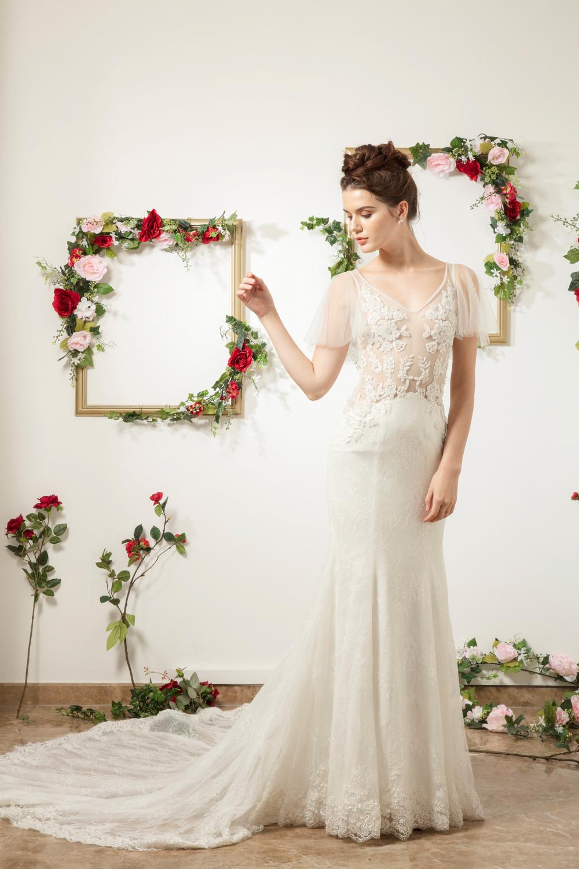Trumpet silhouette wedding dress with translucent bodice by CCM Weddding