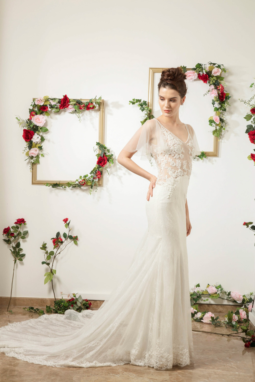 Translucent bodice wedding dress with train by CCM Wedding