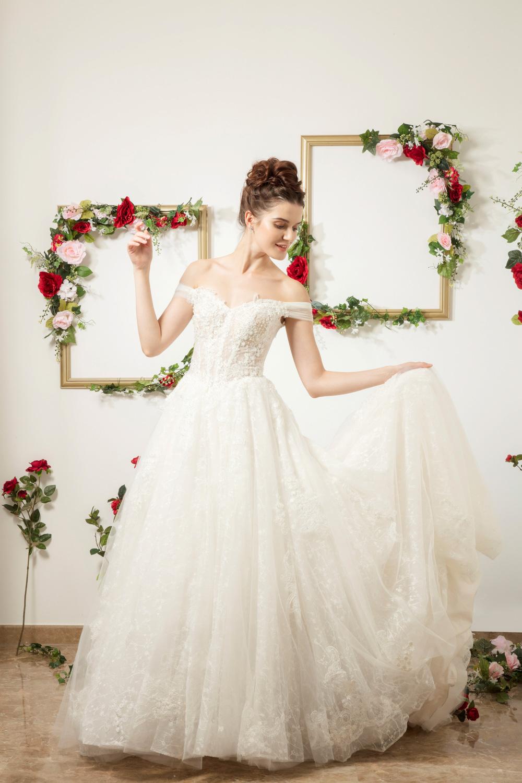 Off the shoulder corset wedding dress by CCM Wedding