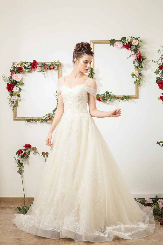 Cap sleeve wedding dress with sweetheart neckline by CCM Wedding
