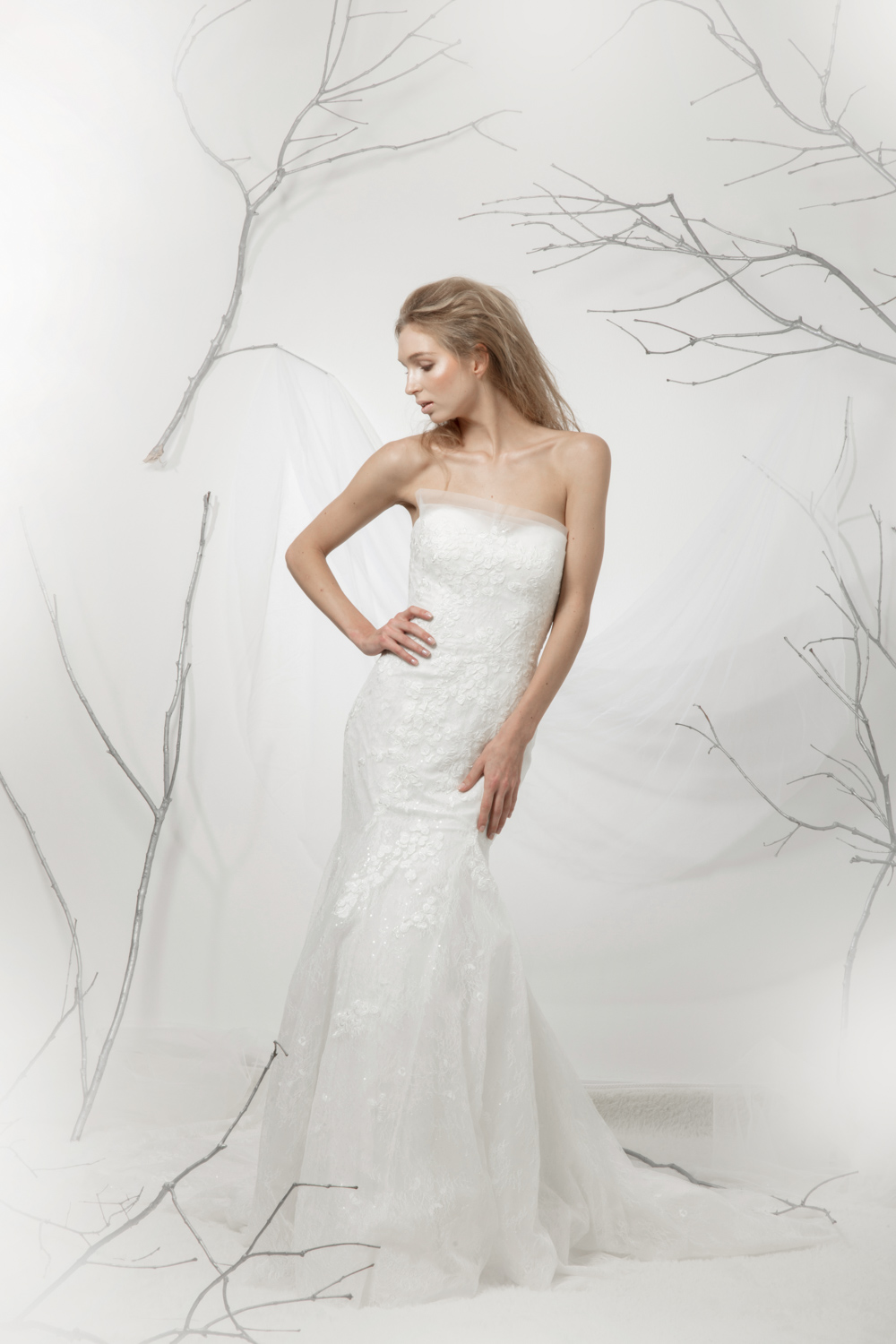 Sleeveless, fit and flare wedding dress by CCM Wedding