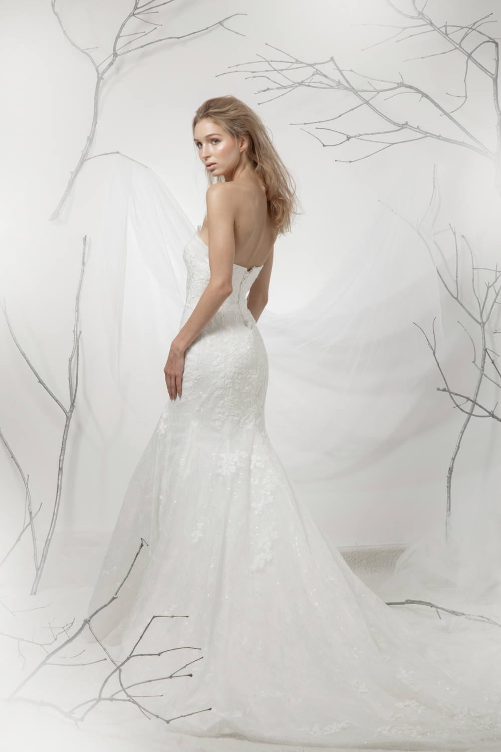 Sleeveless fit and flare wedding dress by CCM Wedding
