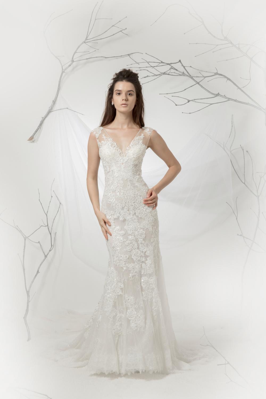 Wedding dress with plunging neckline by CCM Wedding