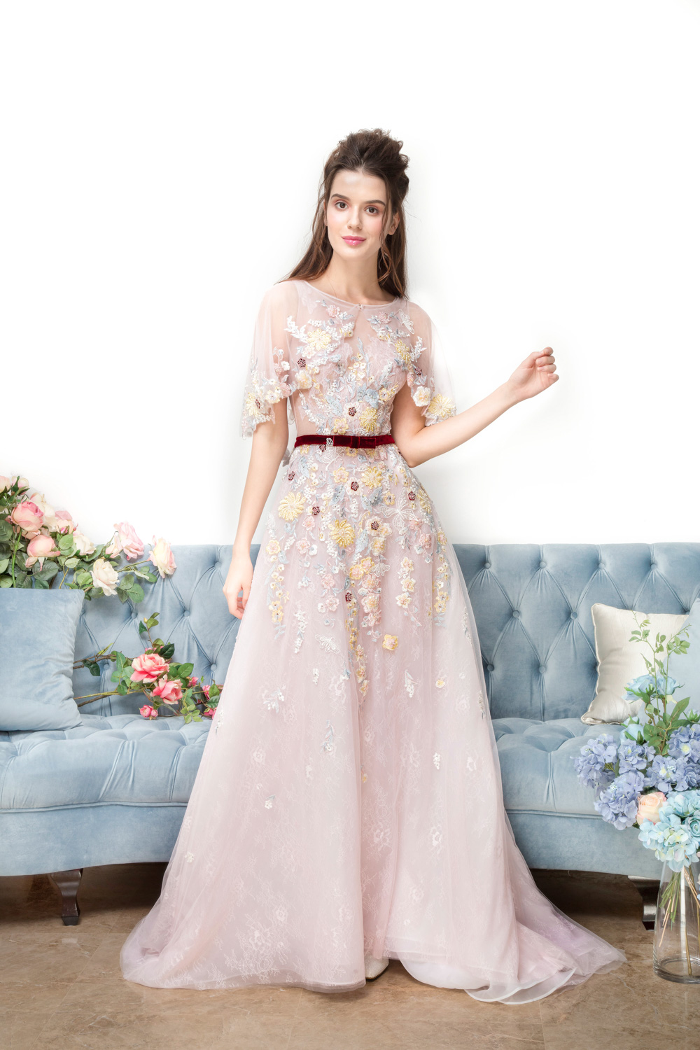 Pink evening gown with shoulder cape detail and velvet bow by CCM Wedding