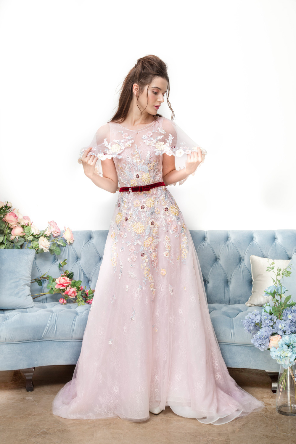 Pink evening gown with red velvet bow by CCM Wedding