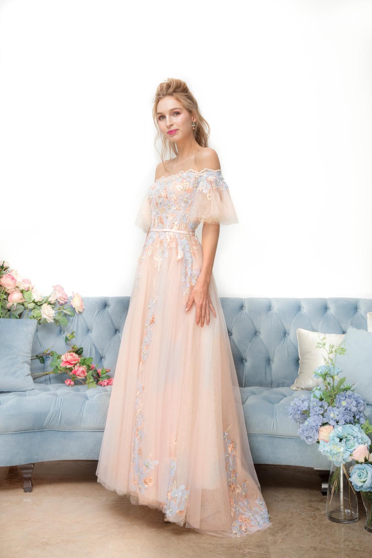 Off shoulder peach evening dress by CCM Wedding
