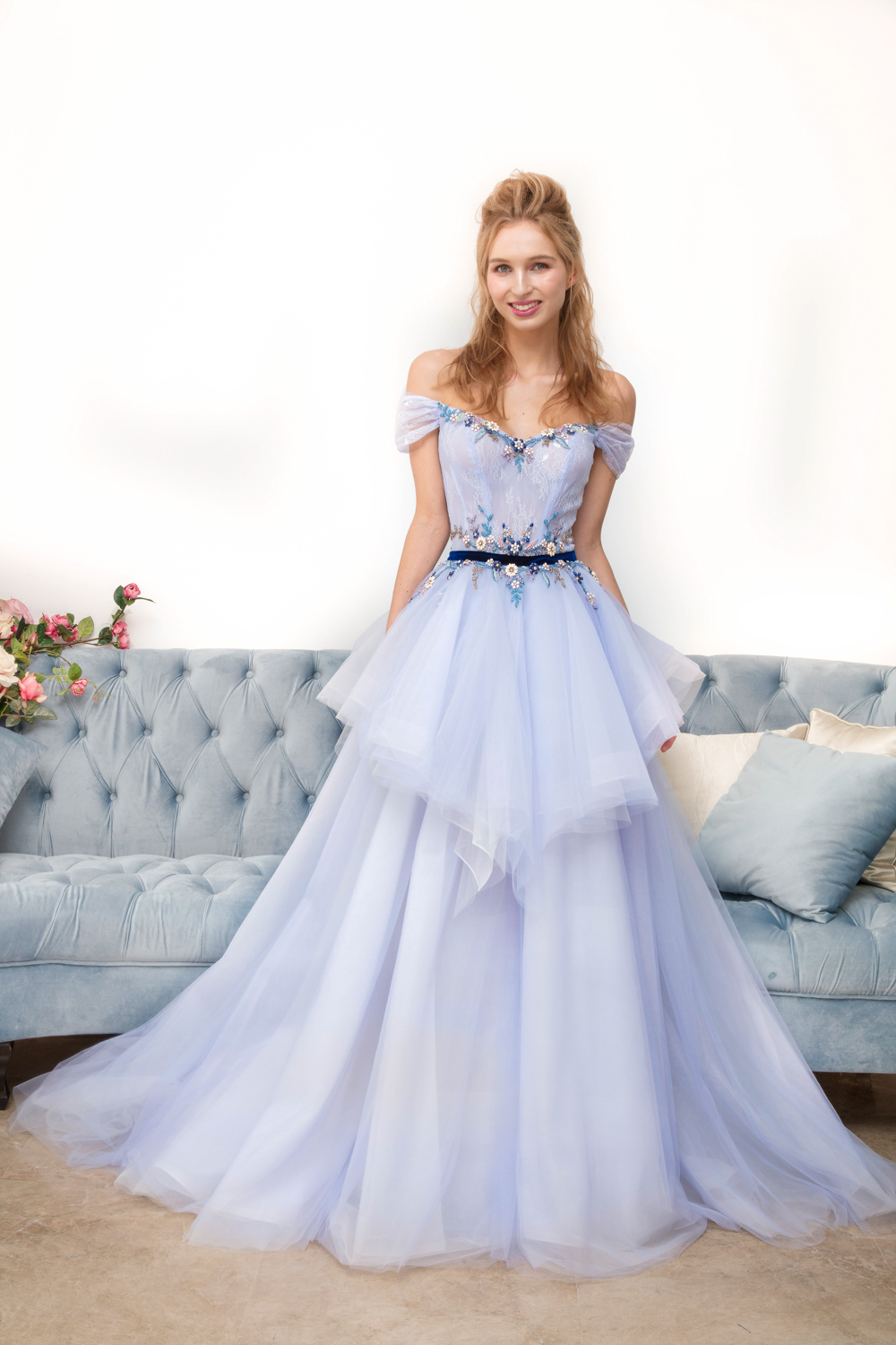 Off the shoulder evening gown with blue velvet evening gown by CCM Wedding
