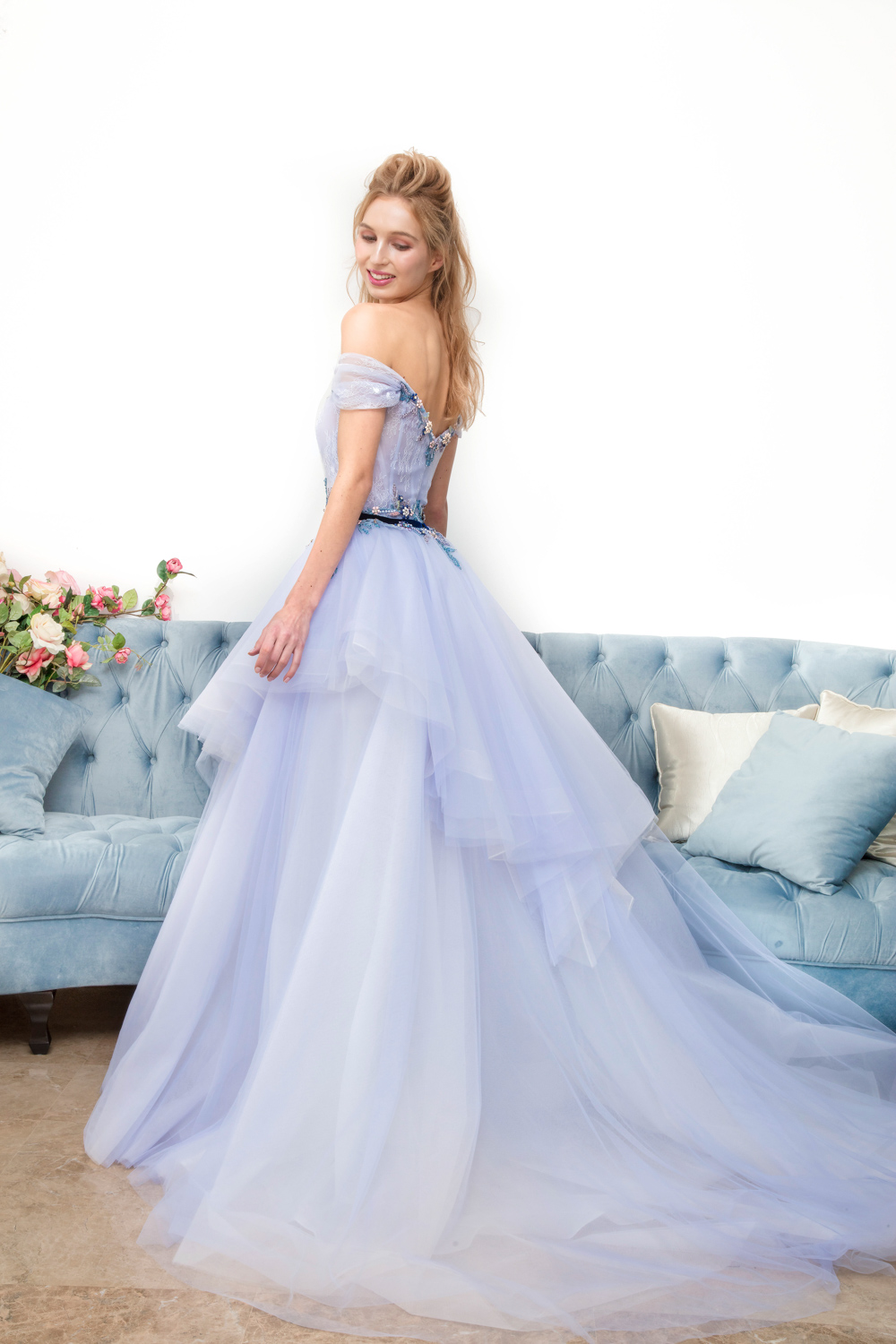 Off the shoulder blue evening gown by CCM Wedding