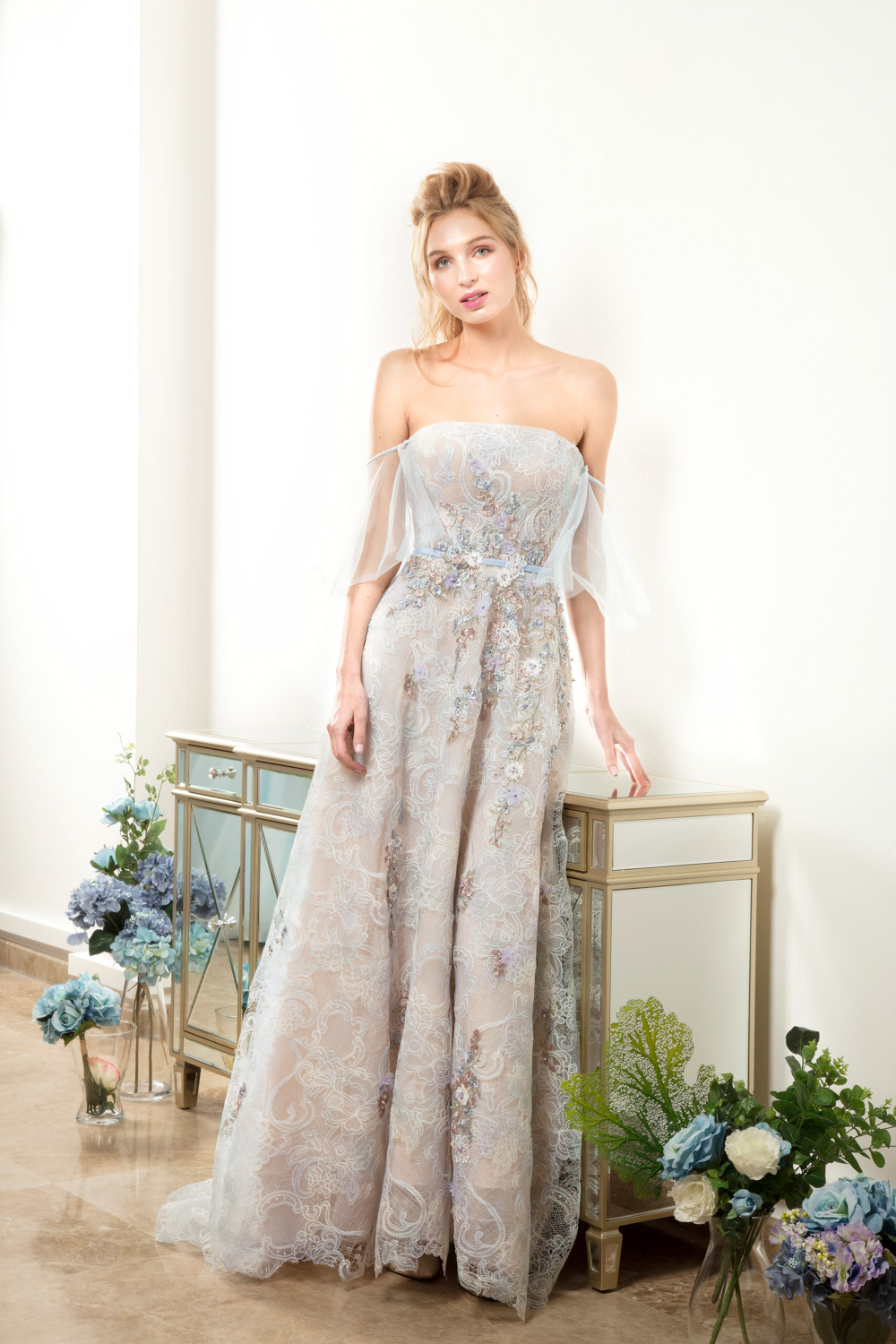 Off the shoulder evening gown by CCM Wedding