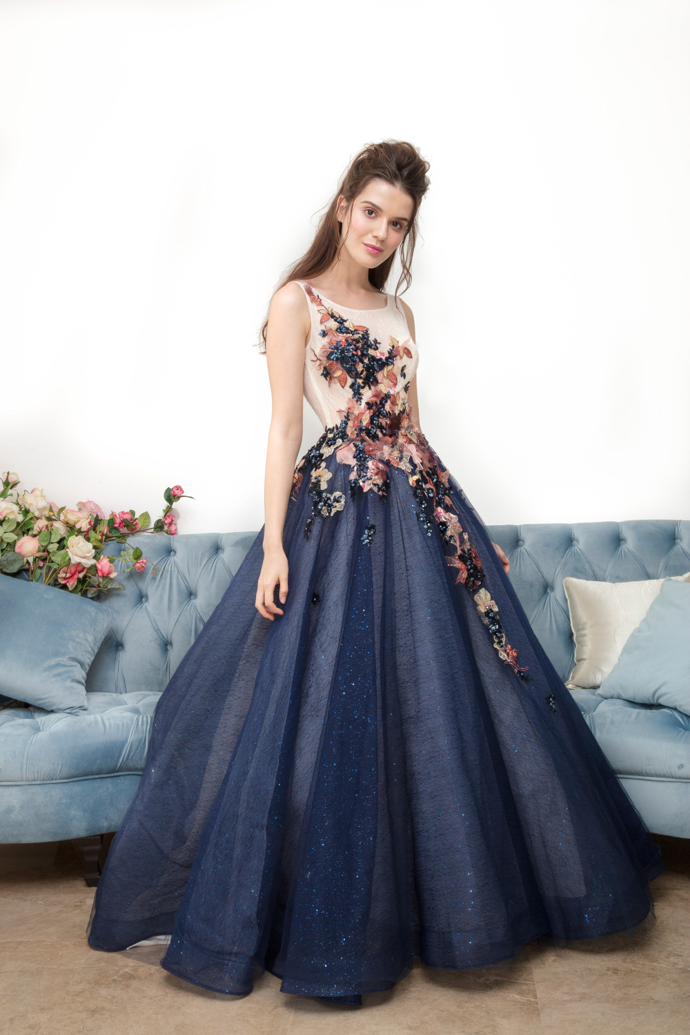 Blue evening dress with floral detail by CCM Wedding