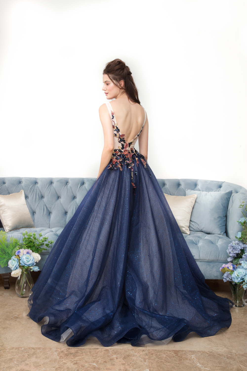 Low back blue evening gown by CCM Wedding