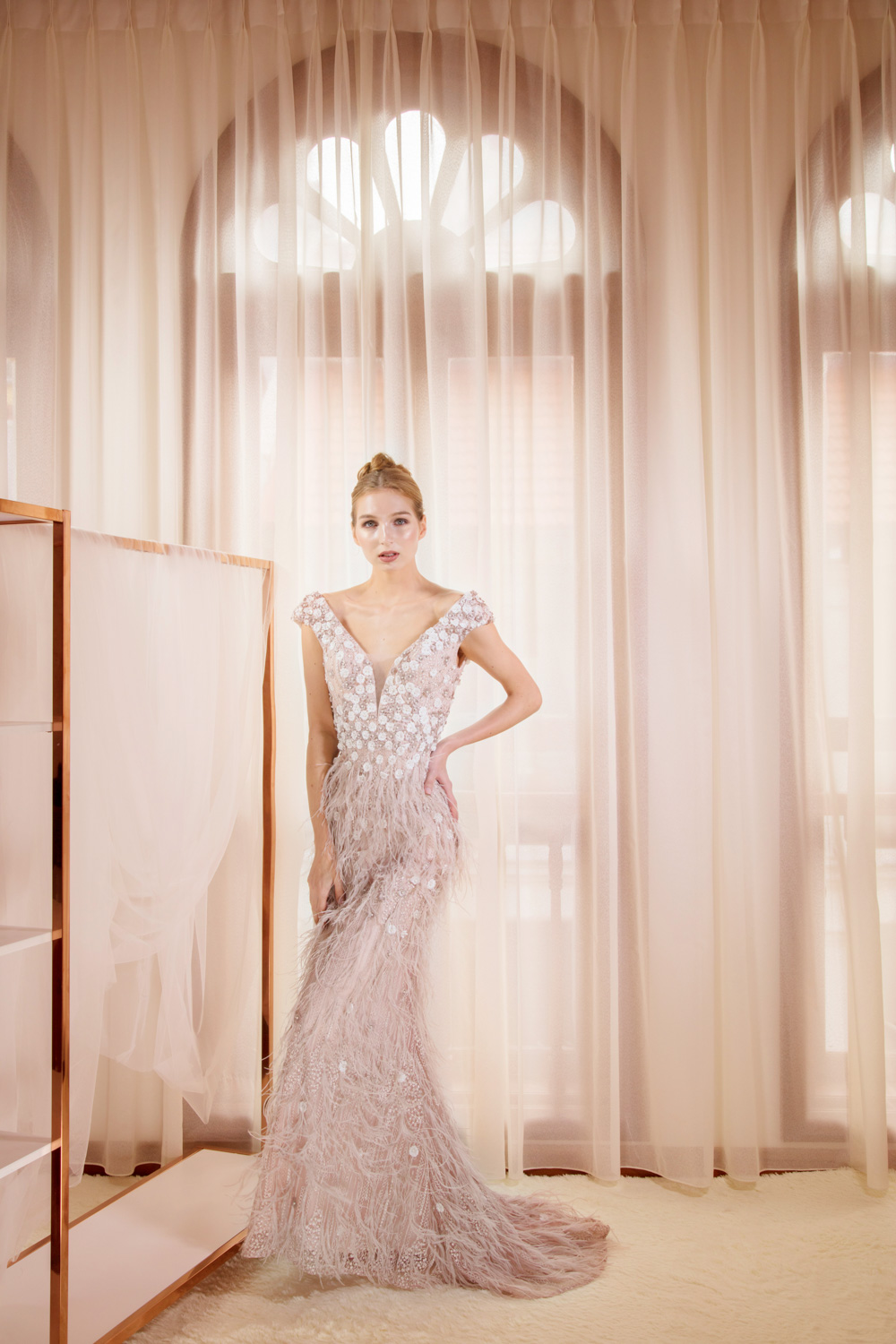Evening gown with feather detail by CCM Wedding