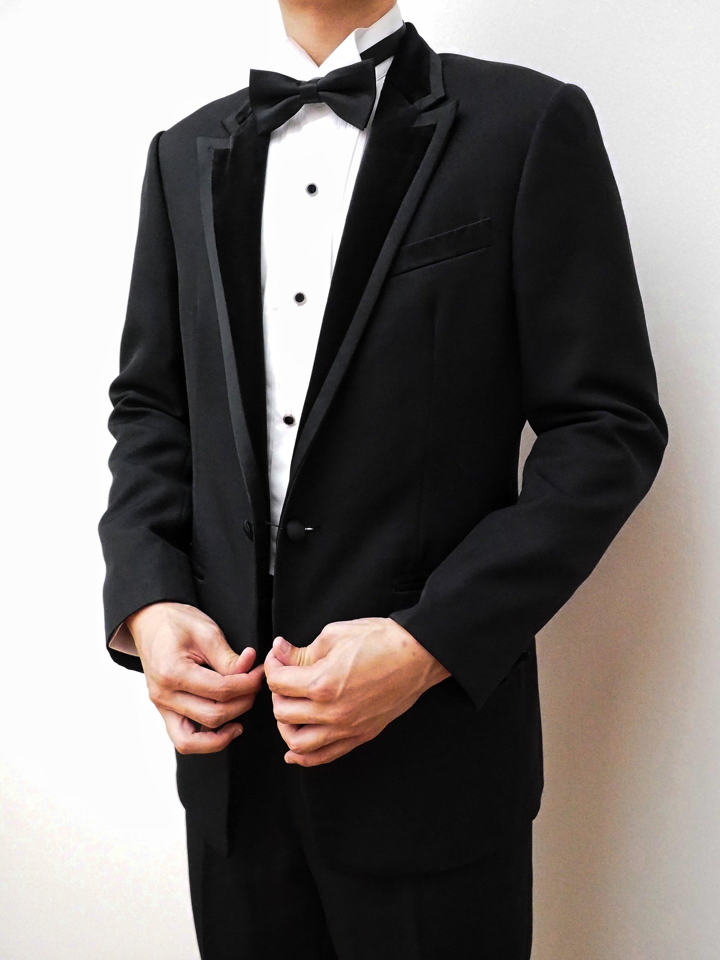 Velvet lapels on a black suit by CCM Wedding