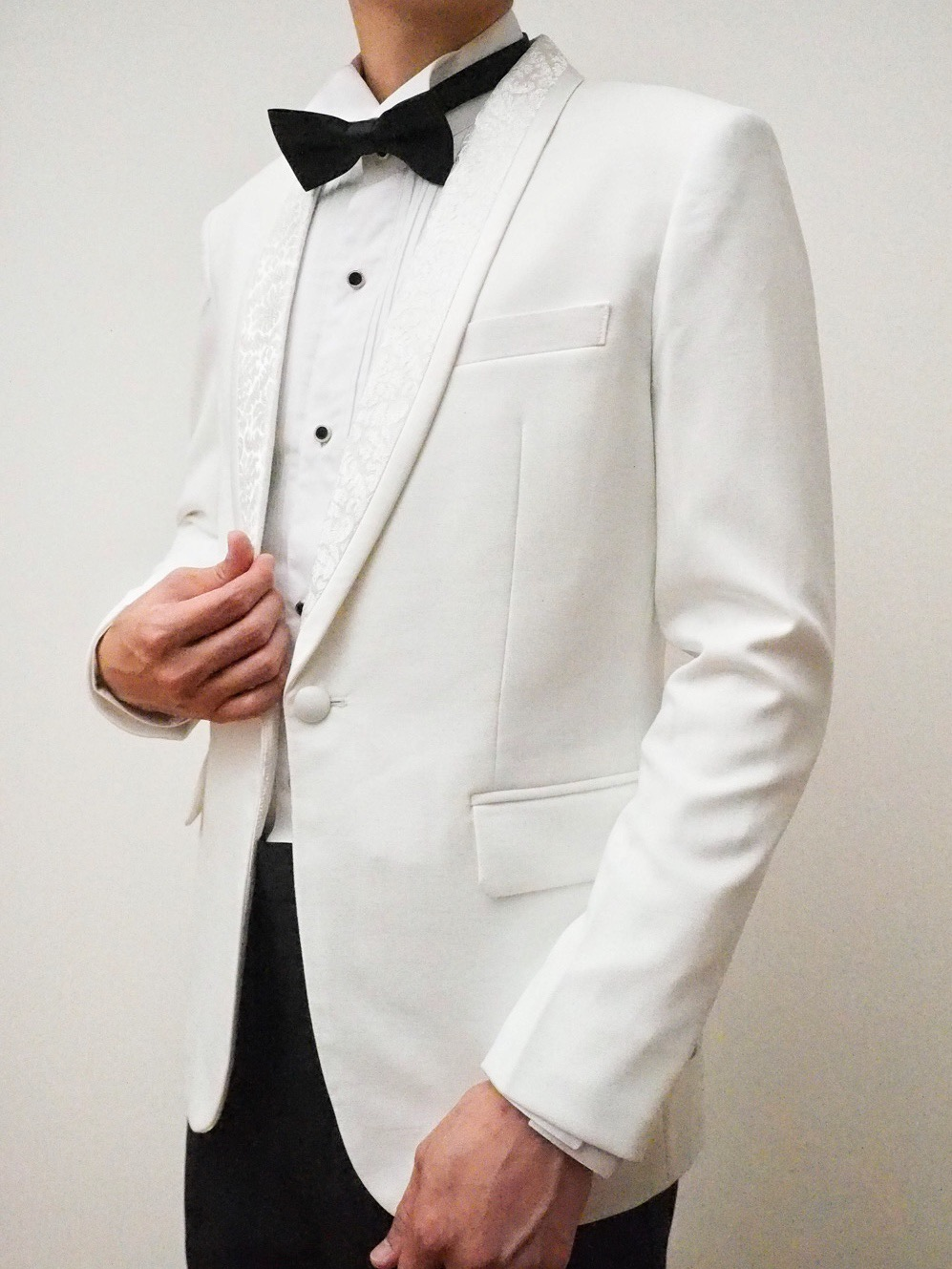 Jacquard fabric on lapels of white suit by CCM Wedding