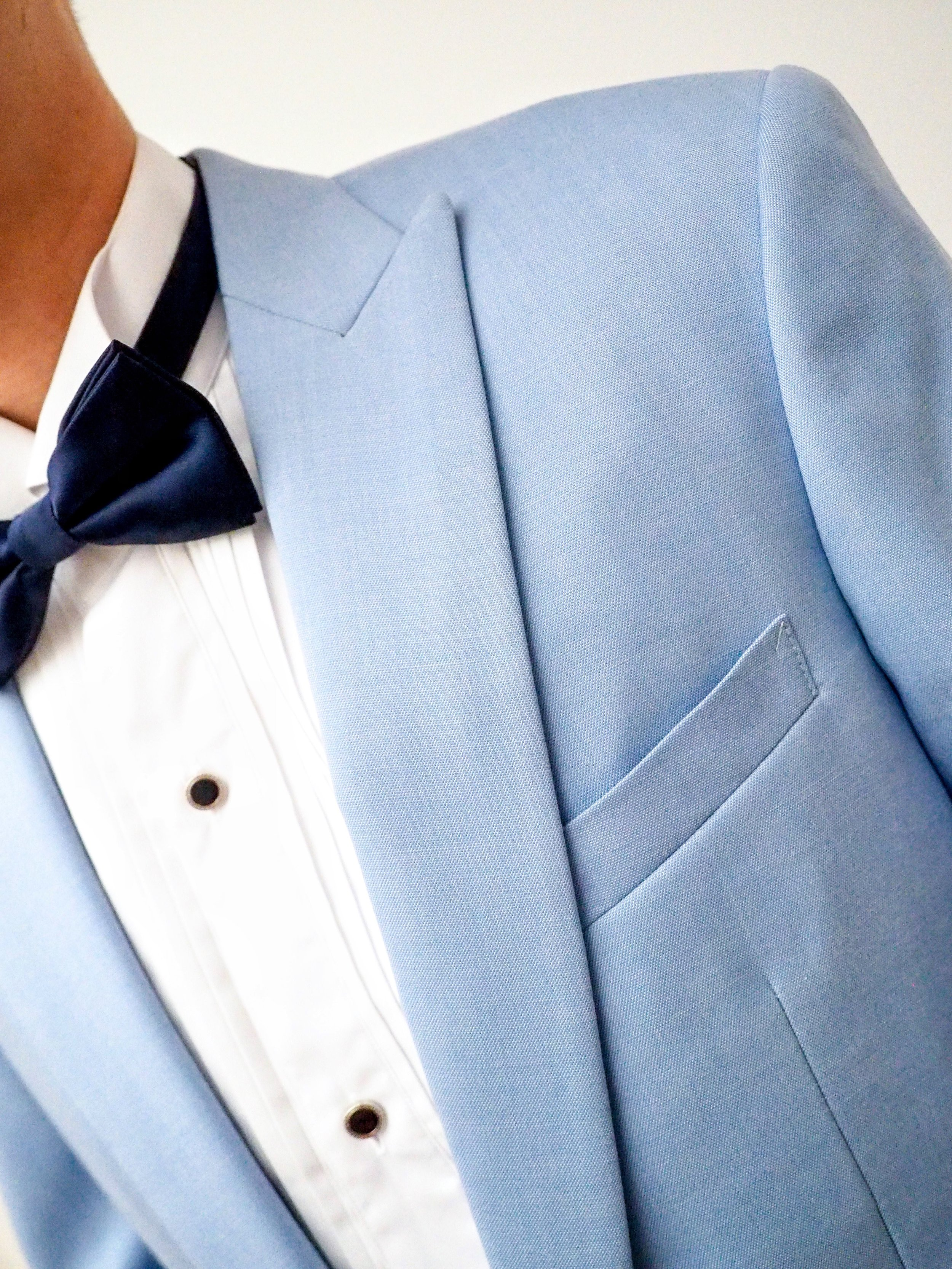 Close up of light blue wedding suit by CCM Wedding