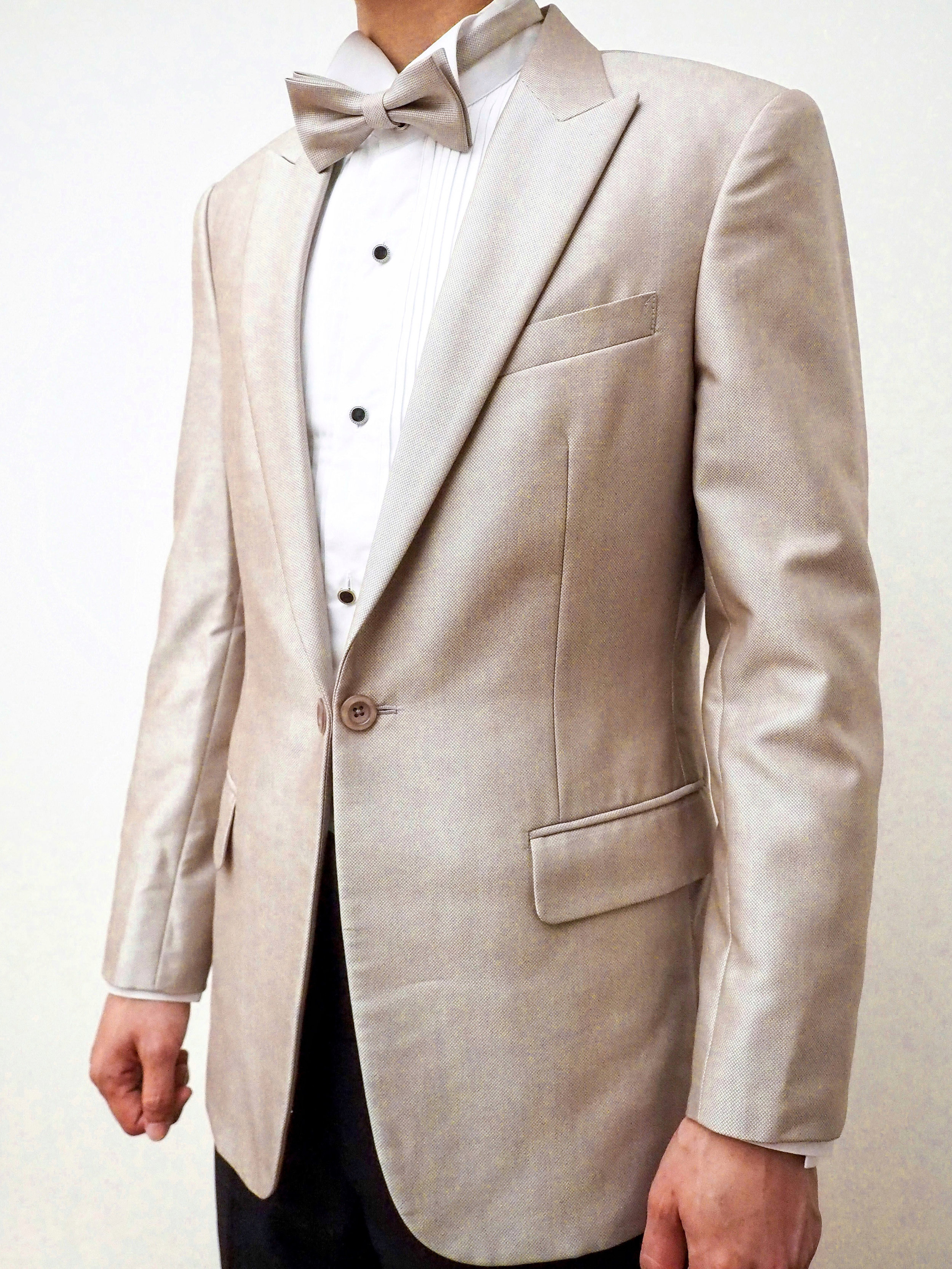 Champagne coloured suit by CCM Wedding