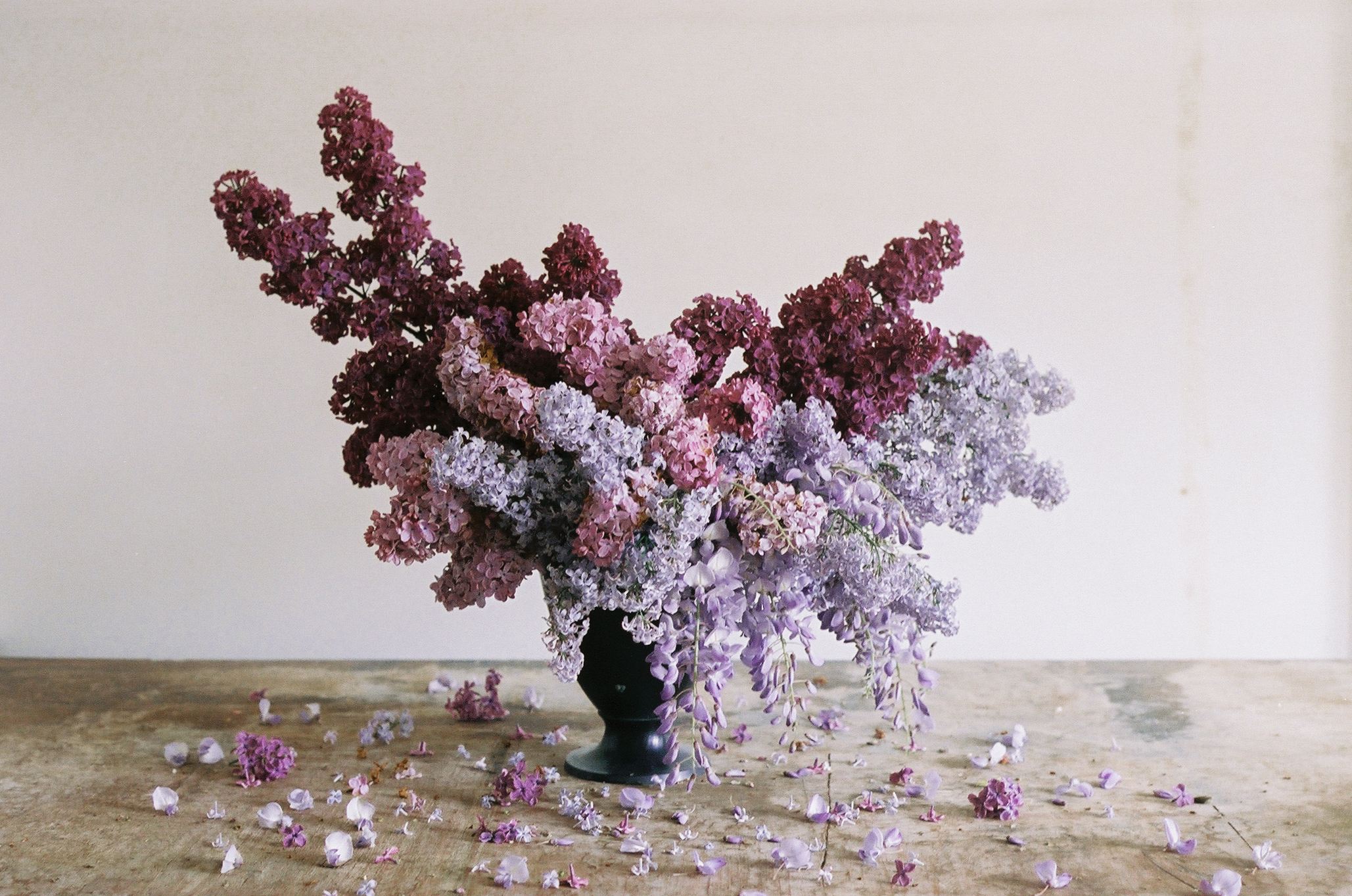 whimsical purple arrangement with lilacs and wisteria - anne van midden
