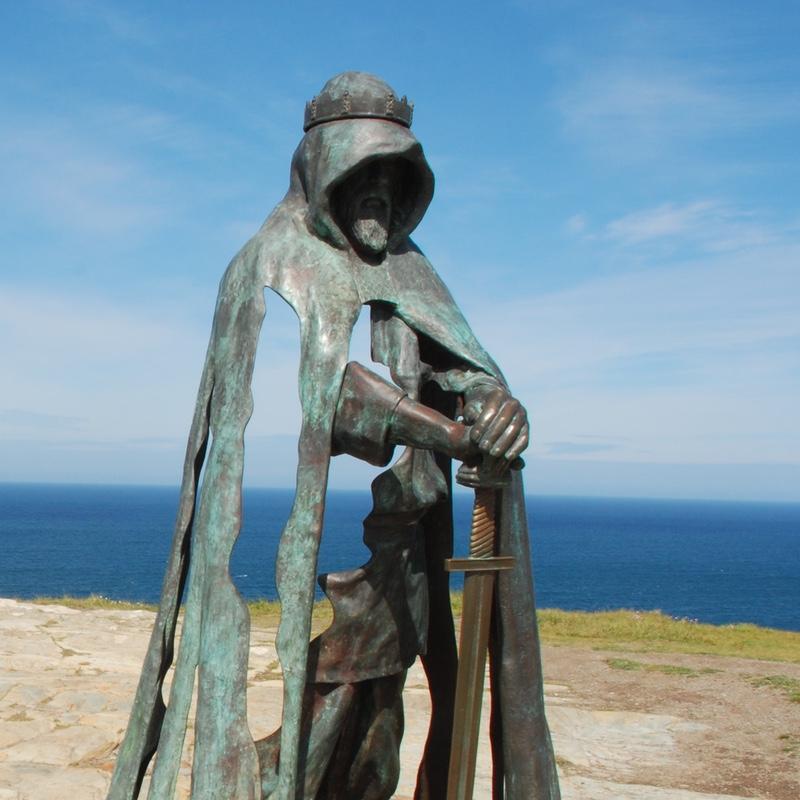 King Arthur's statue on Tintagel Castle overlooking the sea