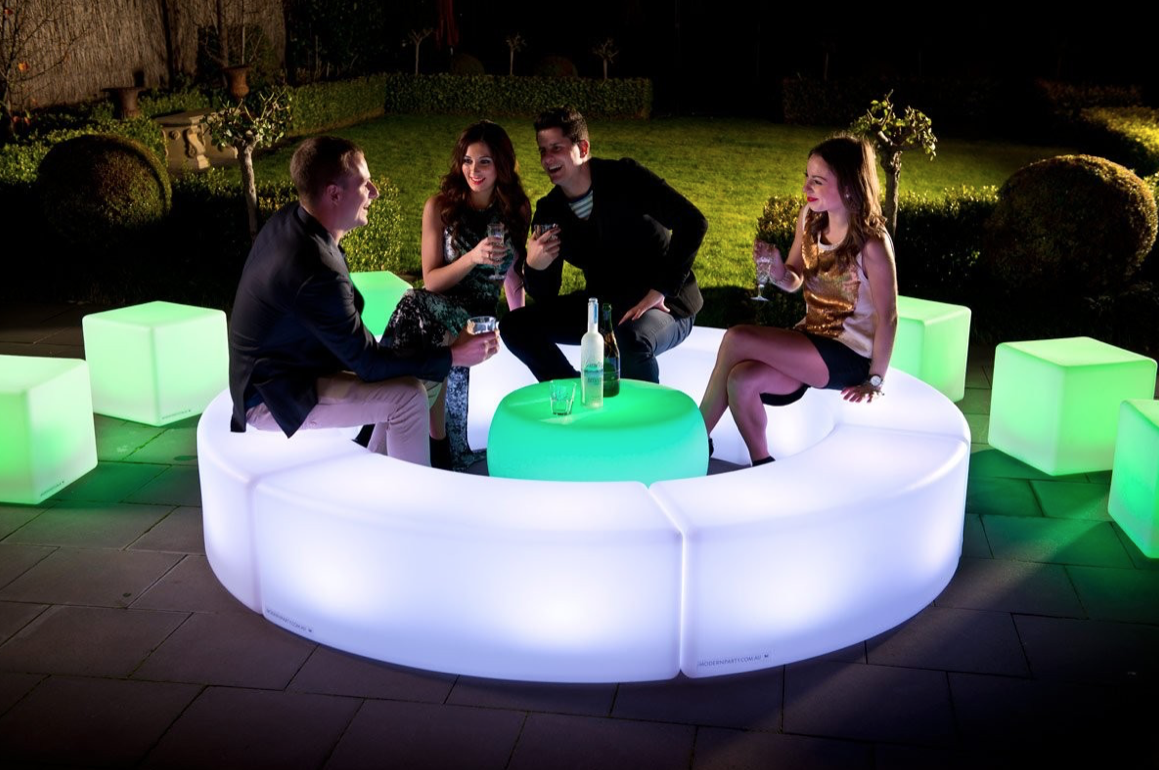 Curved benches and cubes transform a patio into a cool social space.