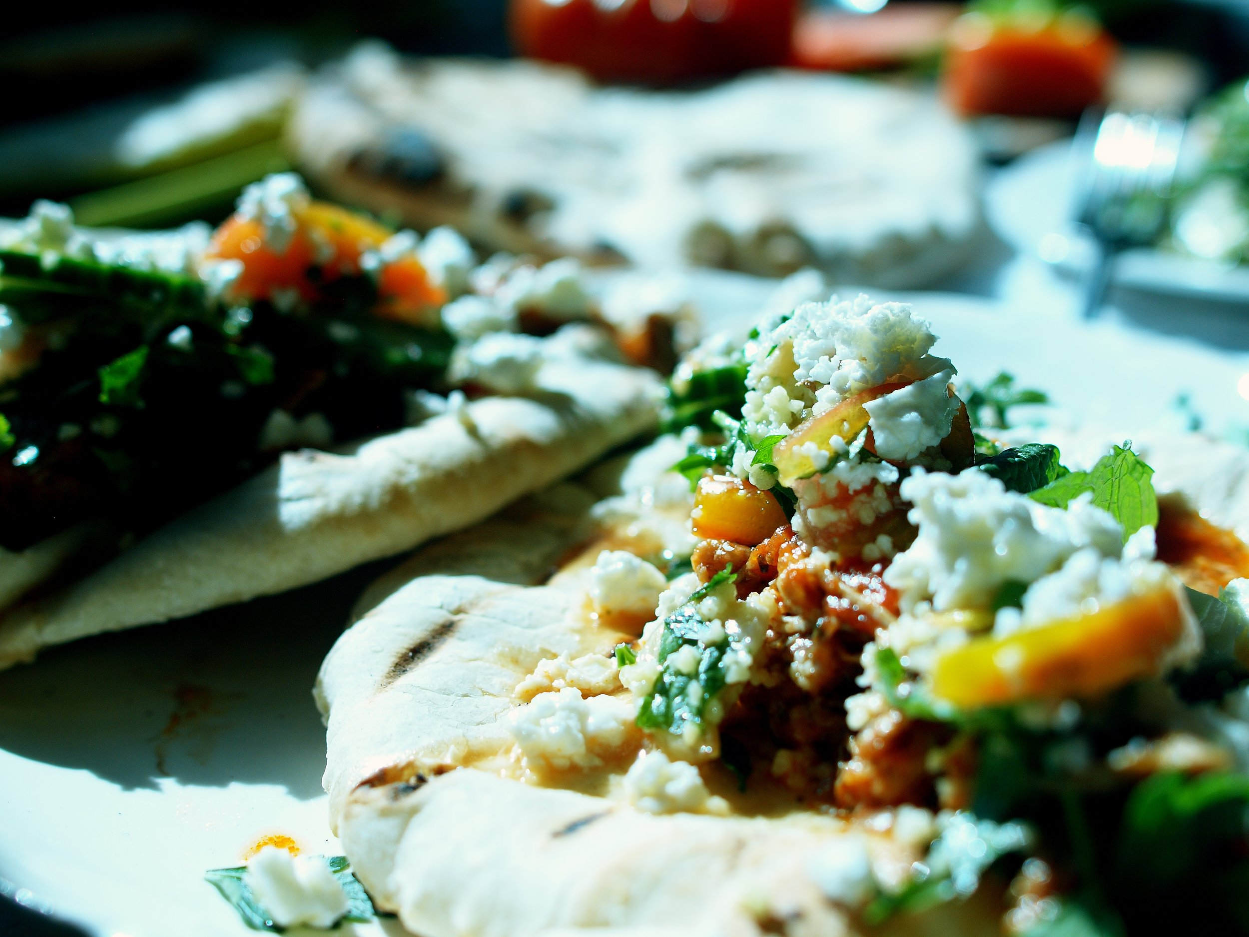 laffa and kokkinisto with feta and heirloom tomato