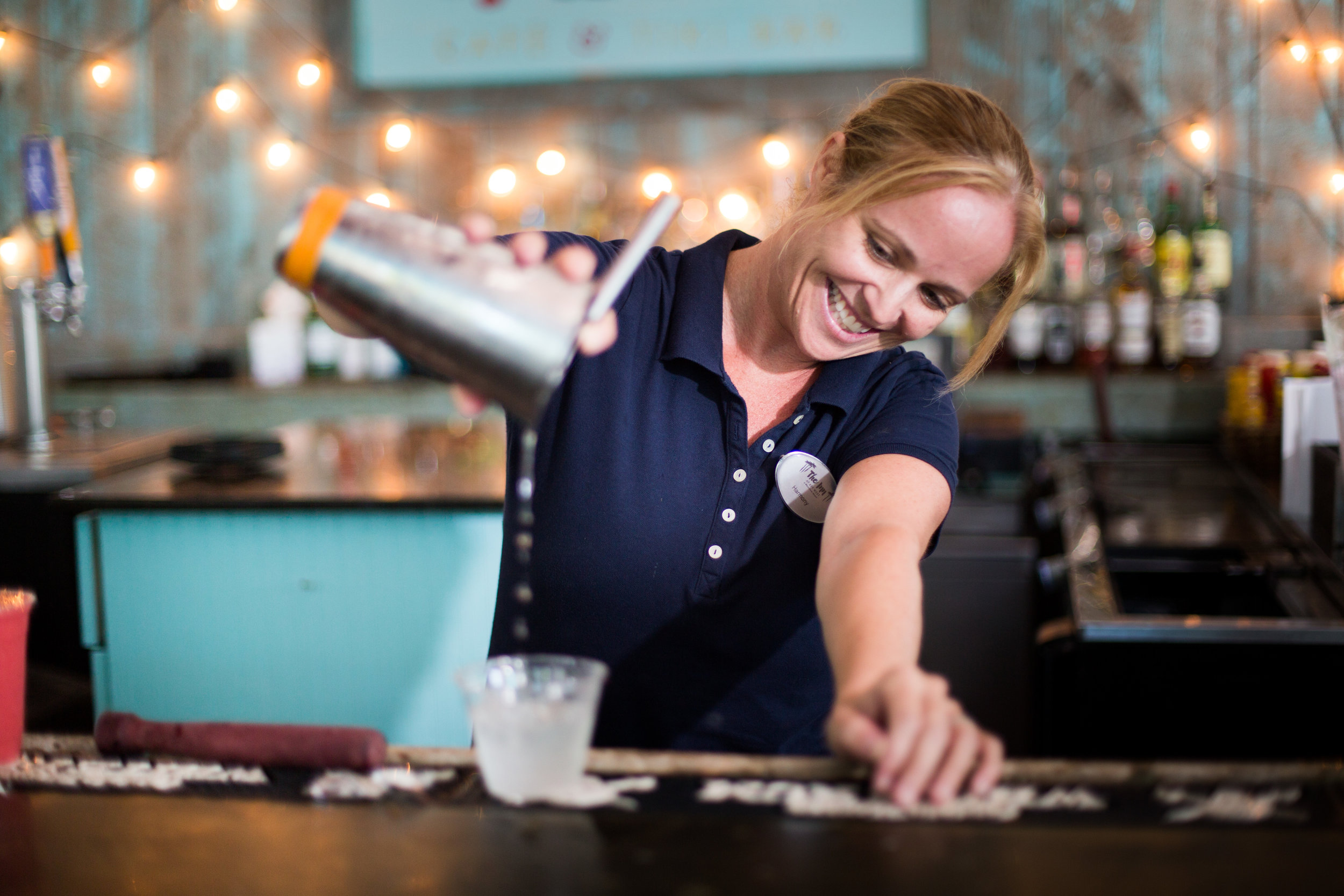 Lifestyle photo shoot of bartender at key west resort tiki bar