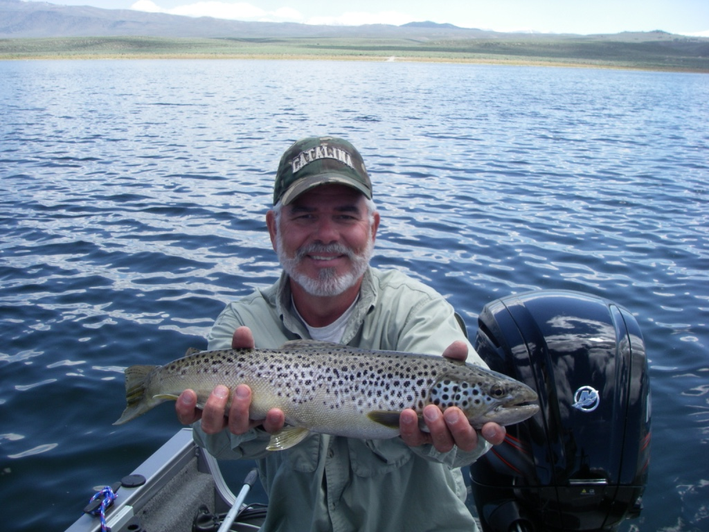 Bishop fly fisher Jim Campbell holds a trophy brown trout he caught midging in 20 feet of water off of North Landing.