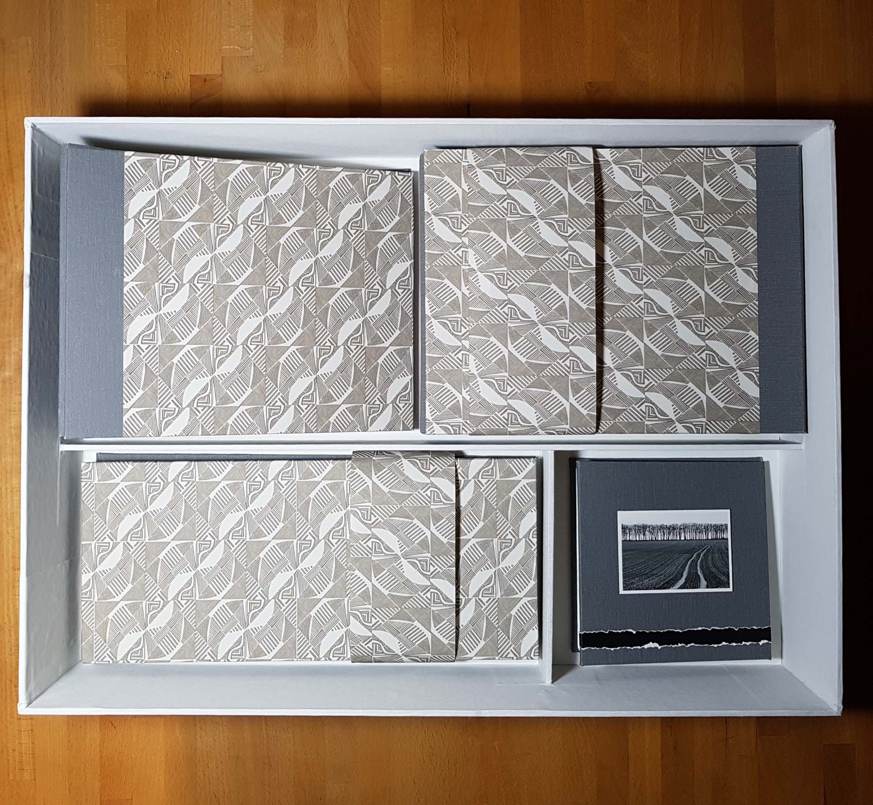 Land Lines triptych partitioned presentation box interior