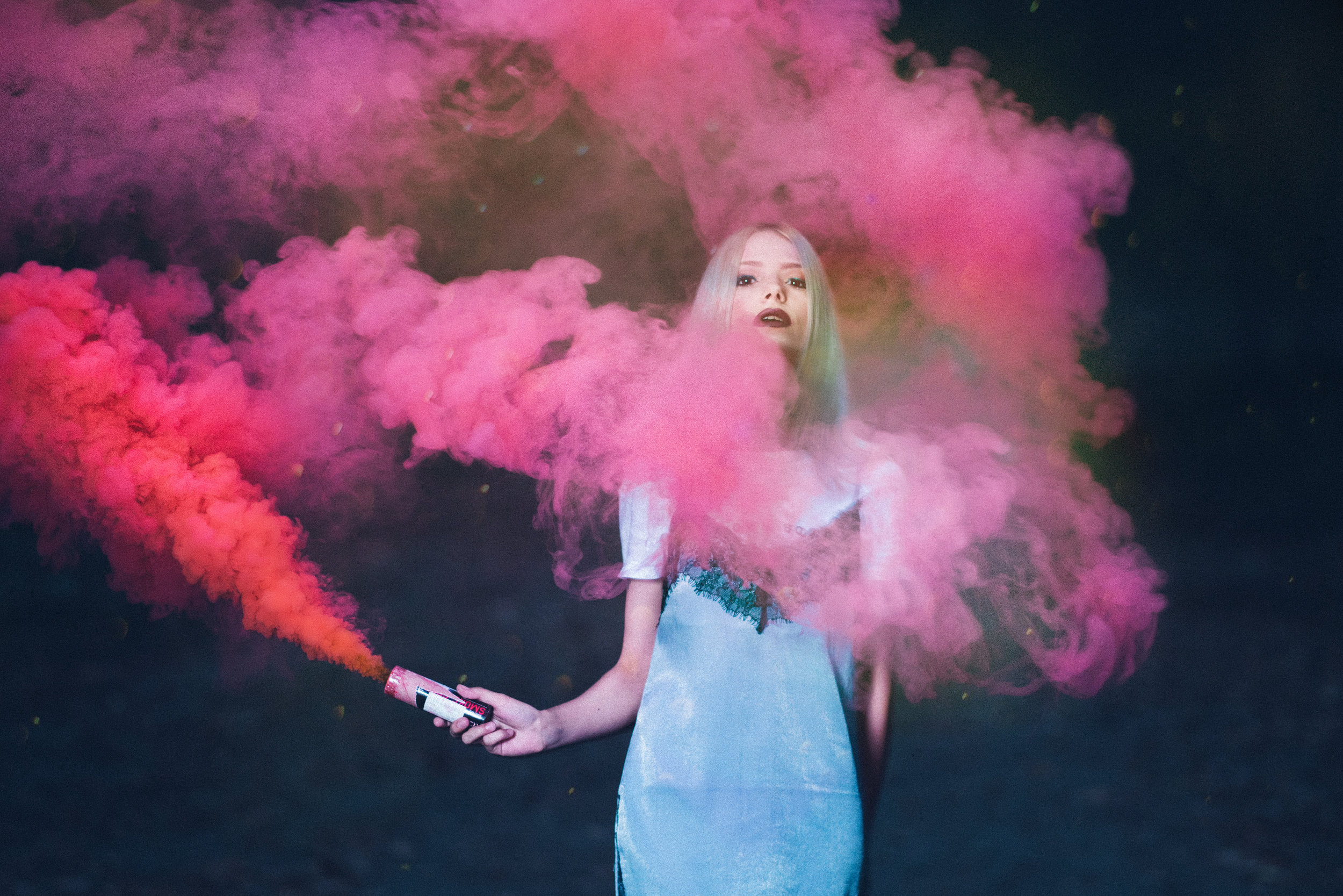 woman in forest playing with pink smoke colour fotografie artistic creative crina popescu .jpg