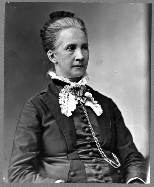 Lawyer Belva Lockwood, half-length portrait, seated, facing right