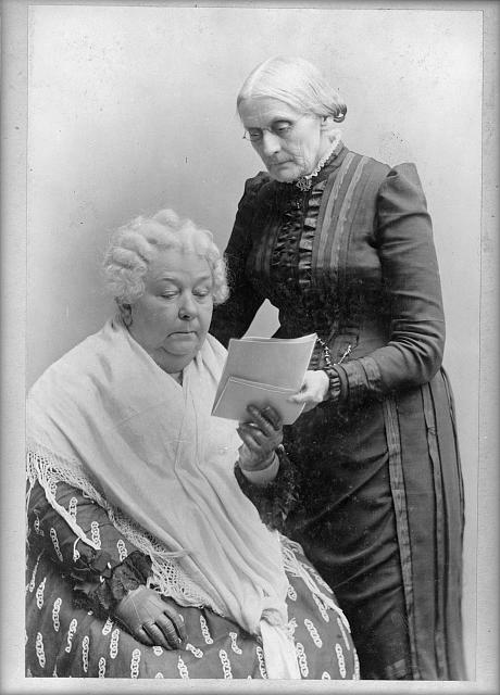 Elizabeth Cady Stanton, seated, and Susan B. Anthony, standing, three-quarter length portrait
