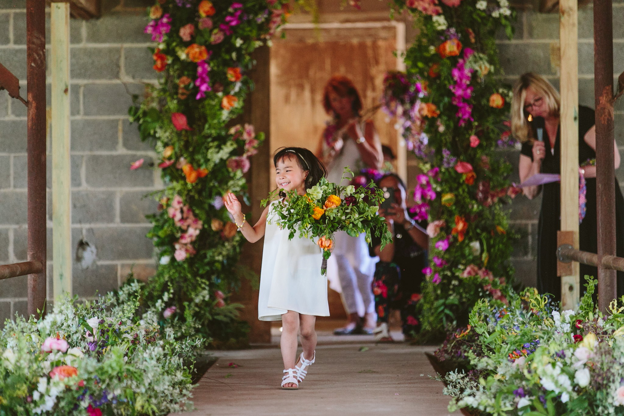 Little one having a blast. I see a proud mom in the background capturing the moment. Bouquet by Jaclyn Millonzi of  Feisty Flowers  in Milwaukee.