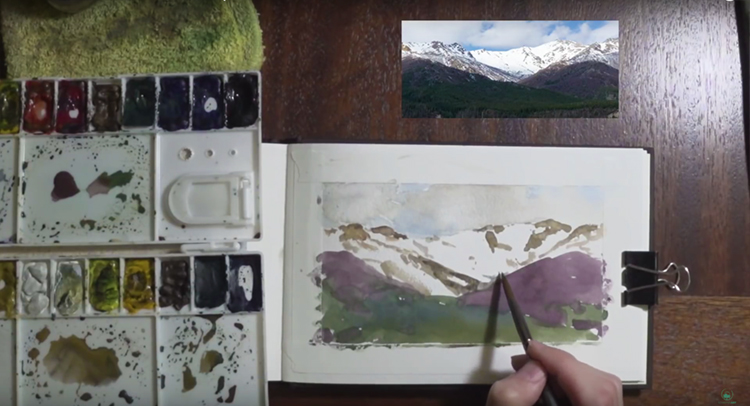 putting-final-touches-mountain-watercolor-painting.jpg