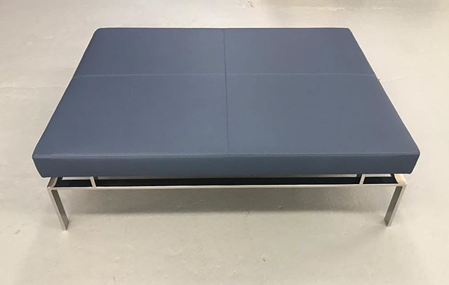 Custom ottoman/coffee table with polished stainless steel base. The leather seat floats over the base with only 4 supports. This was inspired by a sofa base where we made the base taller so it would be suitable for coffee table height. #handcrafted #interiordesign #interiordecor #interiordesigner #homedecor #interiordecorating #decor