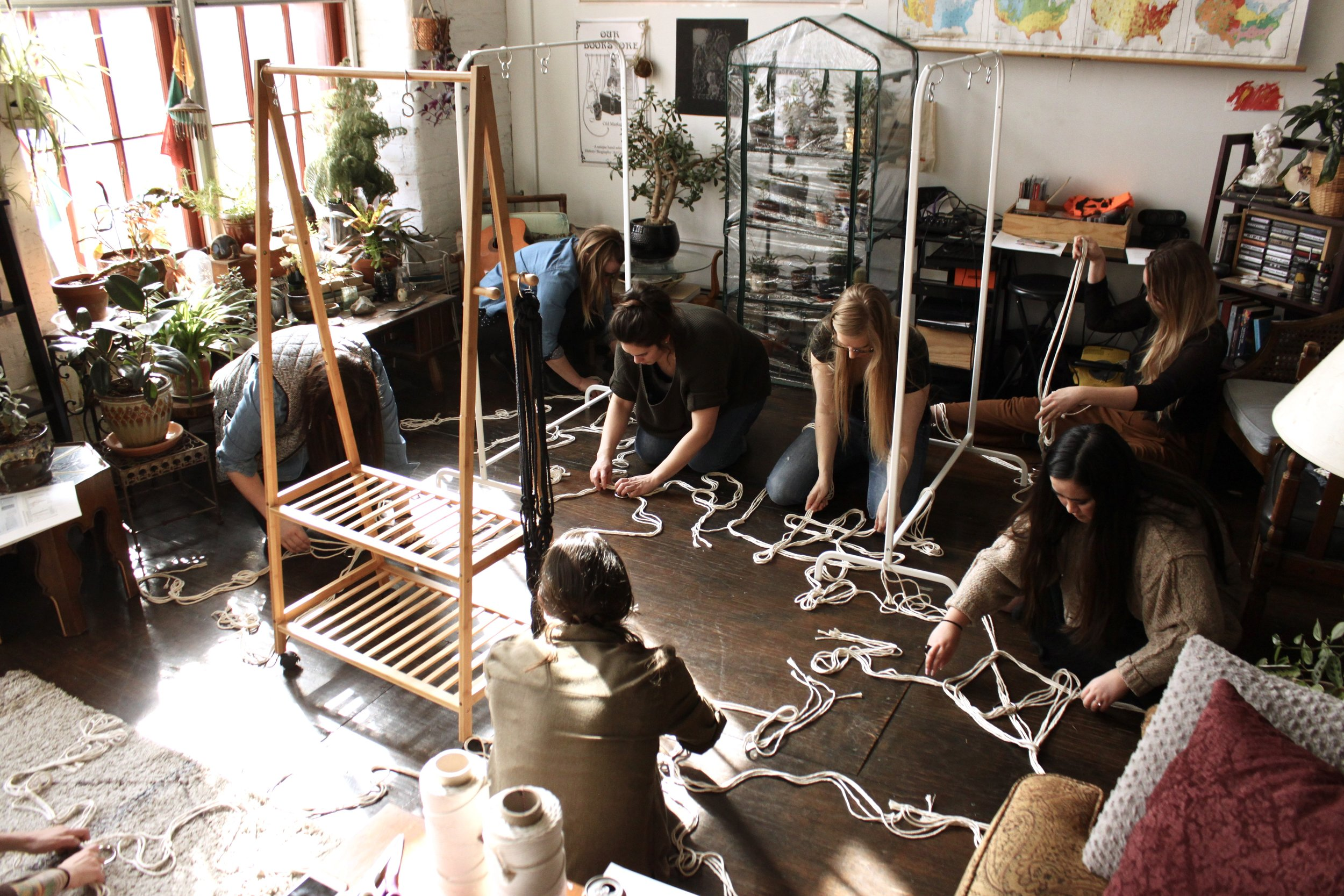 Students master the 4-ply lanyard in the Green House home studio.