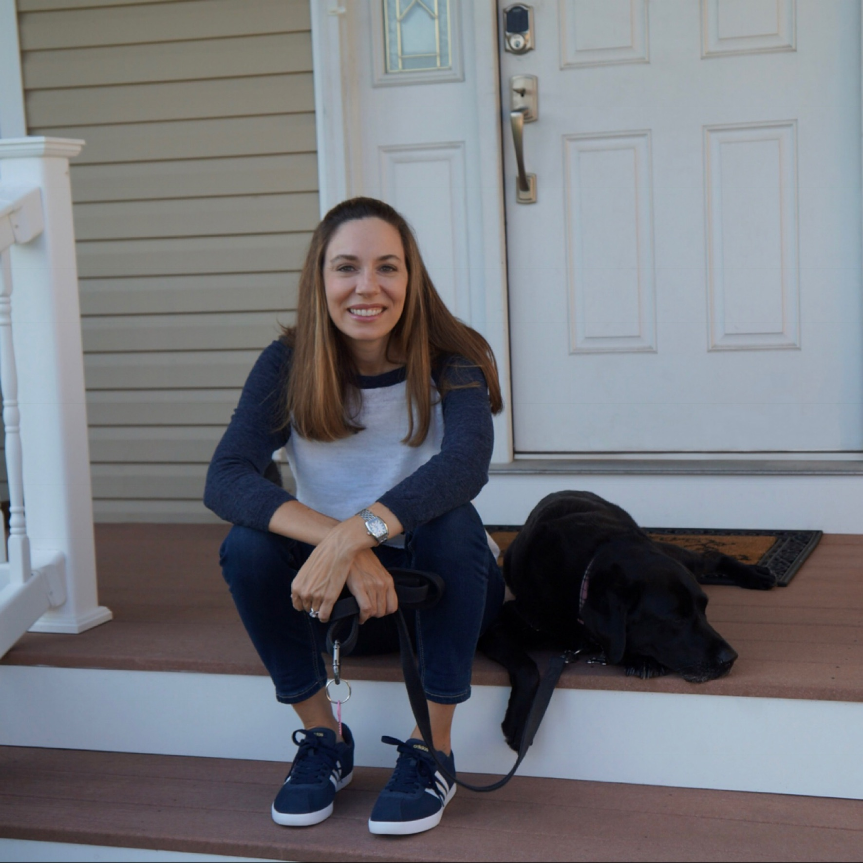 Michelle and our dog on the porch