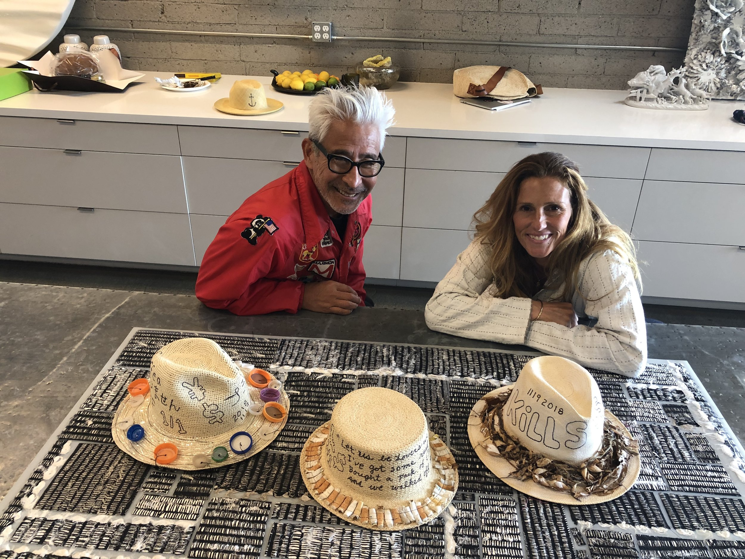 Yoki alongside Florencia, founder of Greenpacha, with his creations. You can find the collaboration at Amaree's in New Port, California.