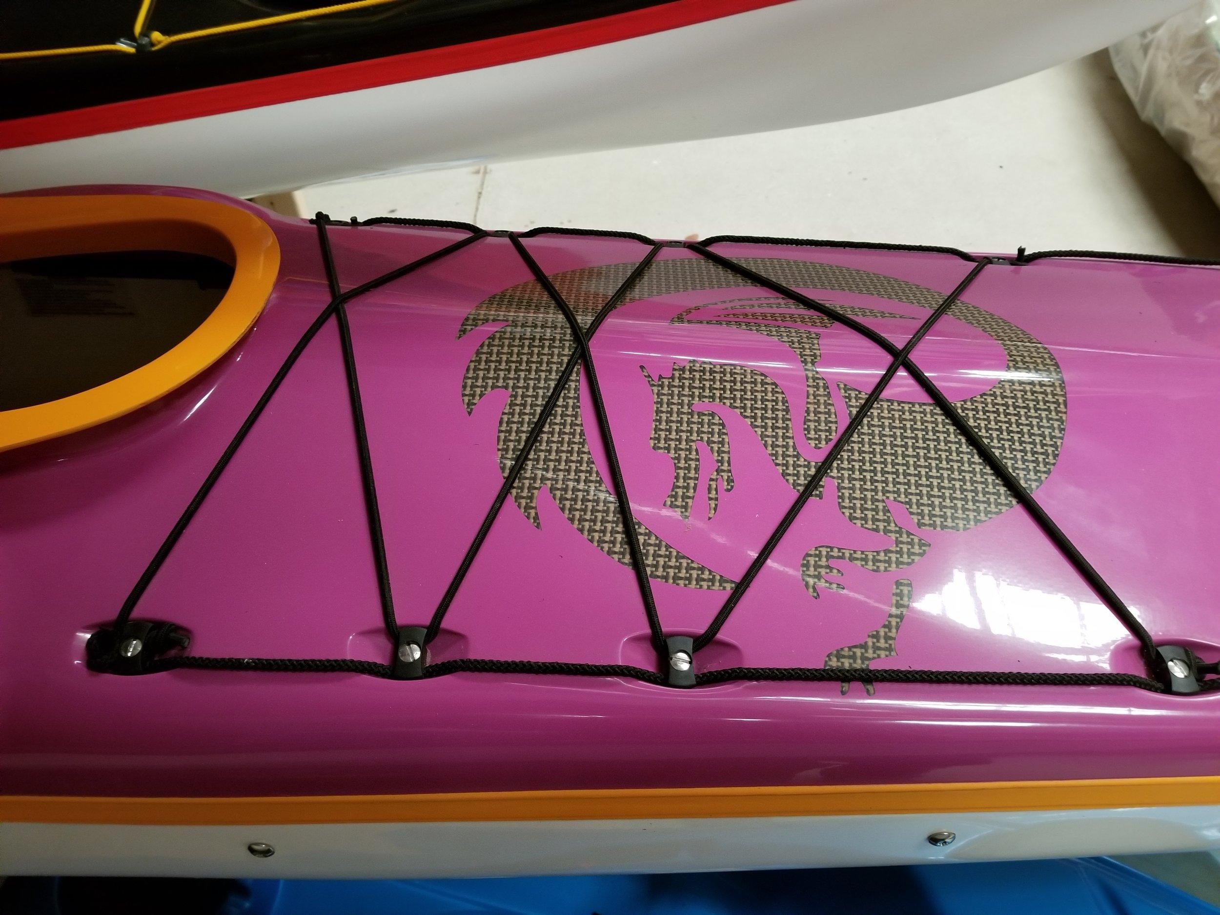 Regular volume.  50/50 layup. Long cockpit, custom bulkhead. Purple deck, white hull,mango combing and seam, clear logo (carbon/kevlar cloth visible).  2016
