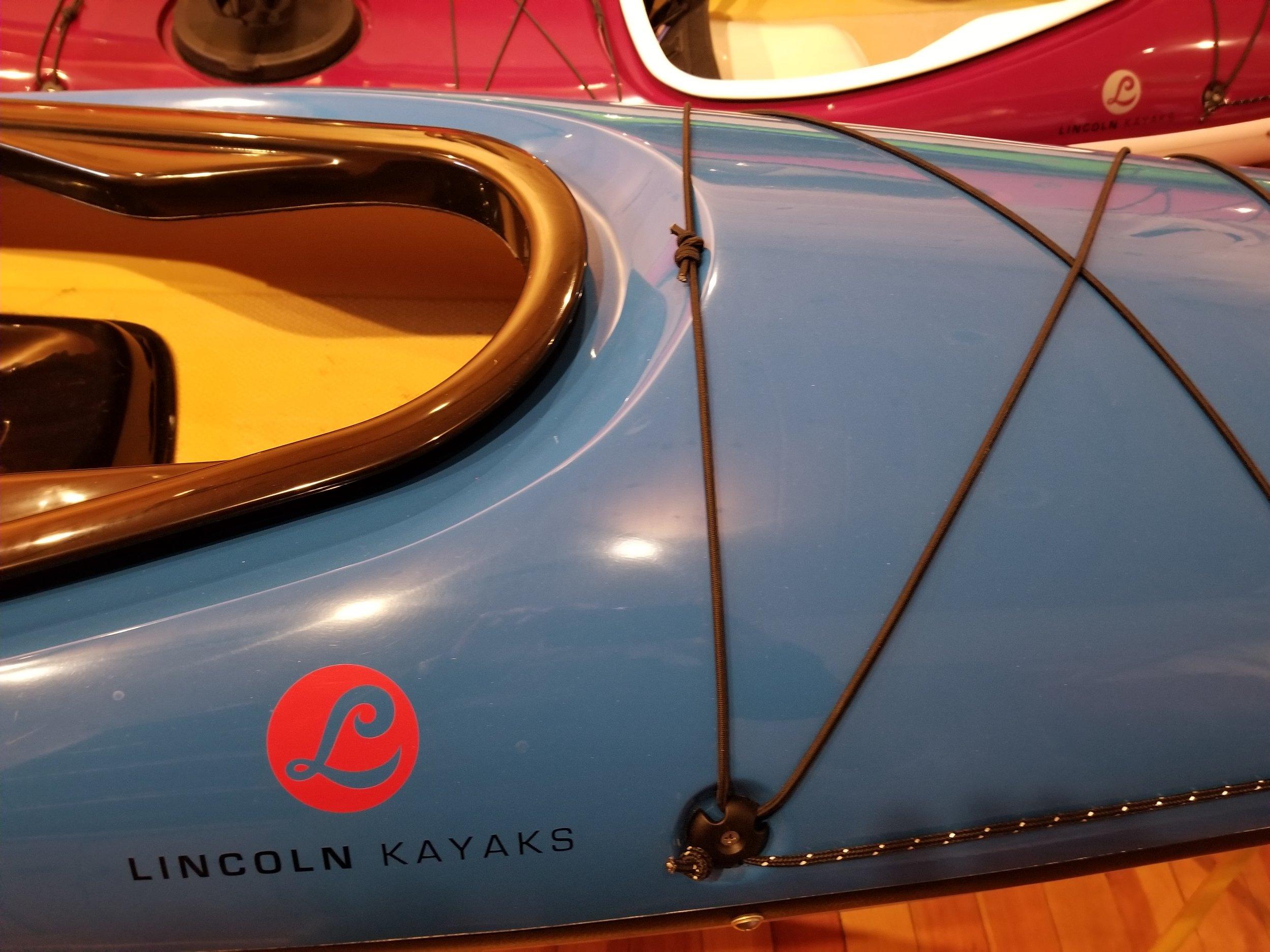 Aramid layup. Blue deck, white hull, black combing and seam.