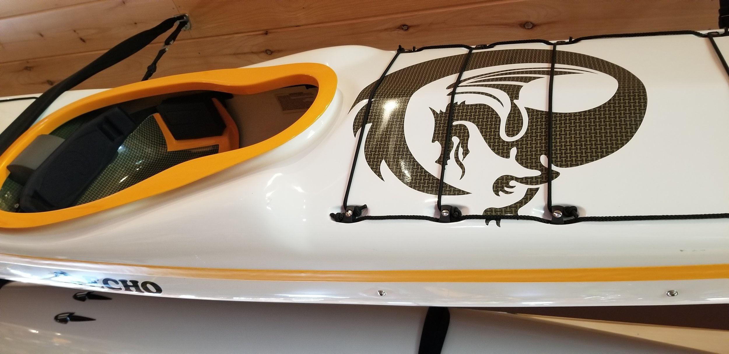Echo:  The Echo is Nigel Dennis Kayak's new expedition and play kayak for smaller paddlers, designed to handle well in surf and rough water. The Echo was designed in response to the growing number of paddlers who wanted a lower-volume Pilgrim Expedition. Image above is in stock Echo (50/50 layup, 2018).