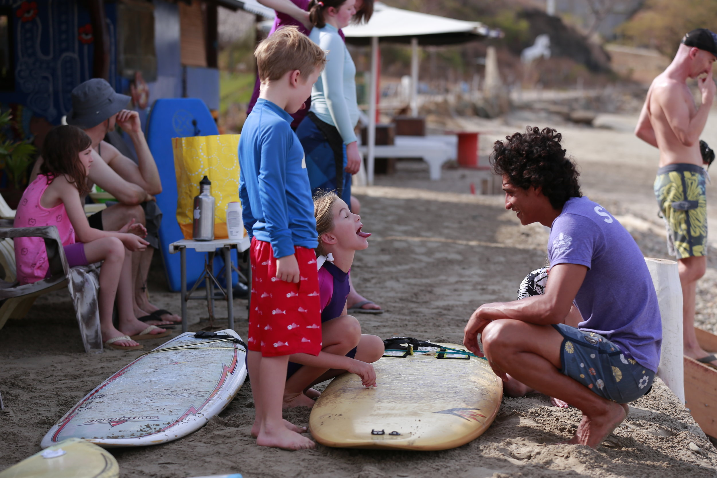 My kids learning to surf and wax their boards