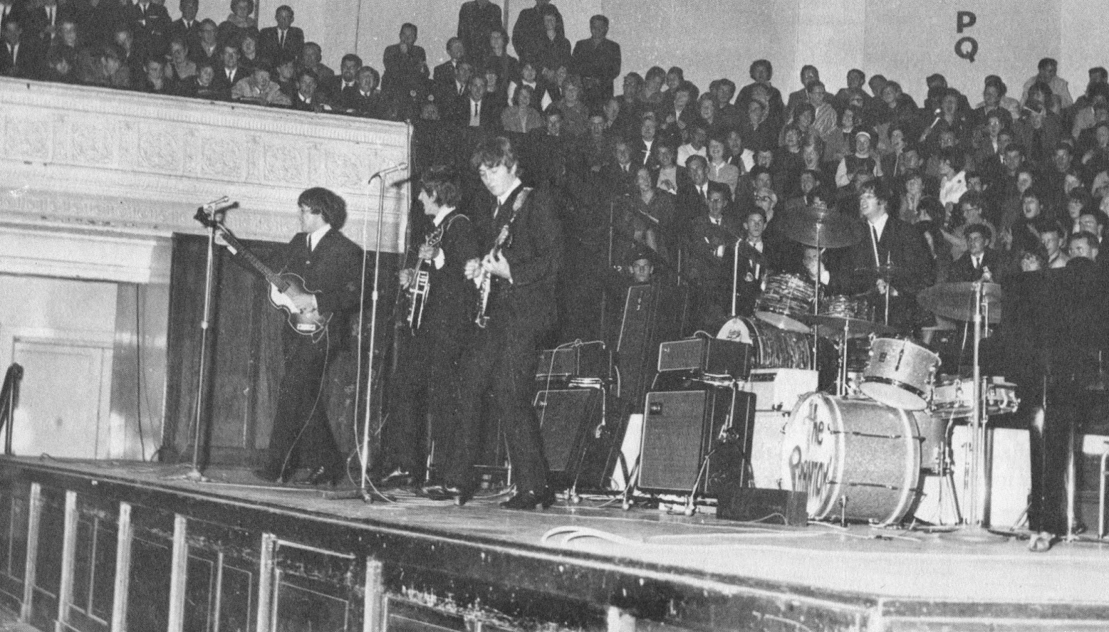 The Beatles performing in the Town Hall, 1964