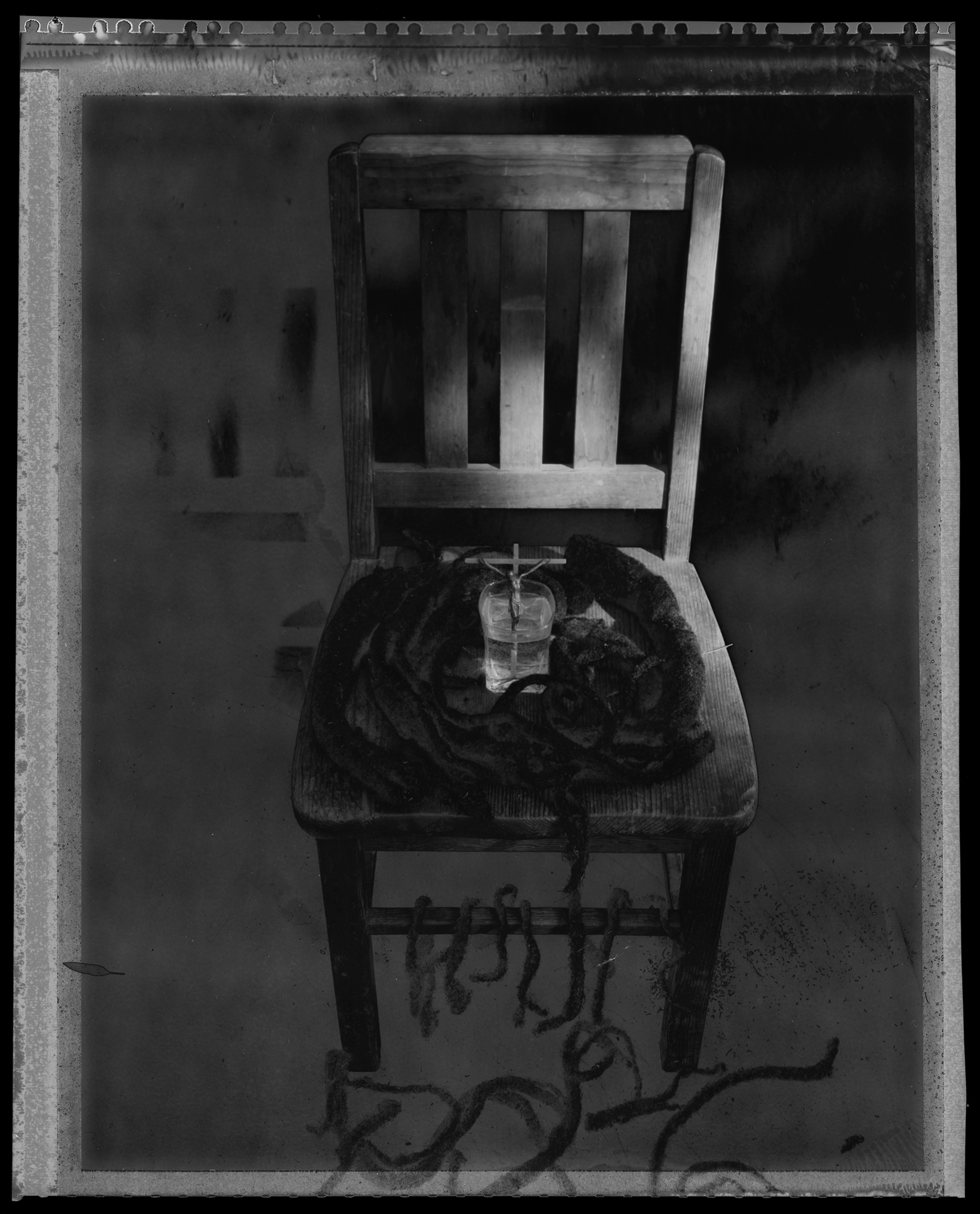 Untitled Throne With Crucifix, Water, &  Shorn Dreadlocks, 1990