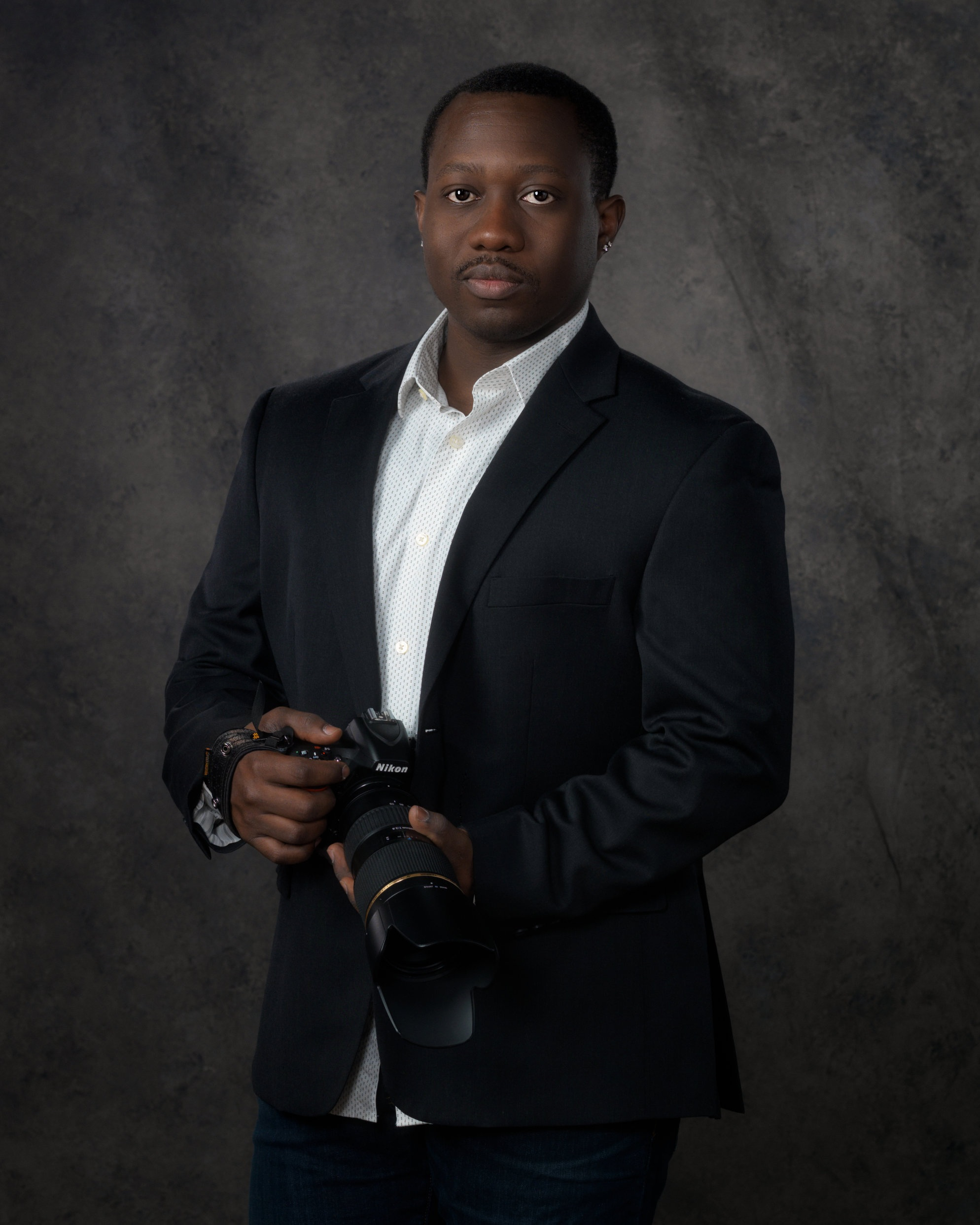 Taye Wilkinson is a portrait photographer. He served in the United States Navy for 12 years. He has been interested in photography since the age of 15. He is an uncle, brother, and owner of a black lab named, Brix.