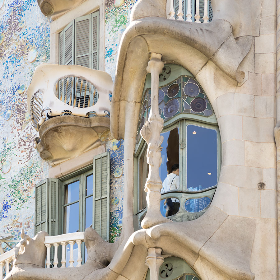 The House of Bones, Casa Batllo in Barcelona showing it's skeleton exterior. The fascination from the work of Antoni Gaudi is inspired by the forms of nature. While the majority of the built world up to this point included unnaturally straight and flat surfaces, Gaudi made each of his creations take the curved forms of nature, as if his buildings were shaped and molded by hand.