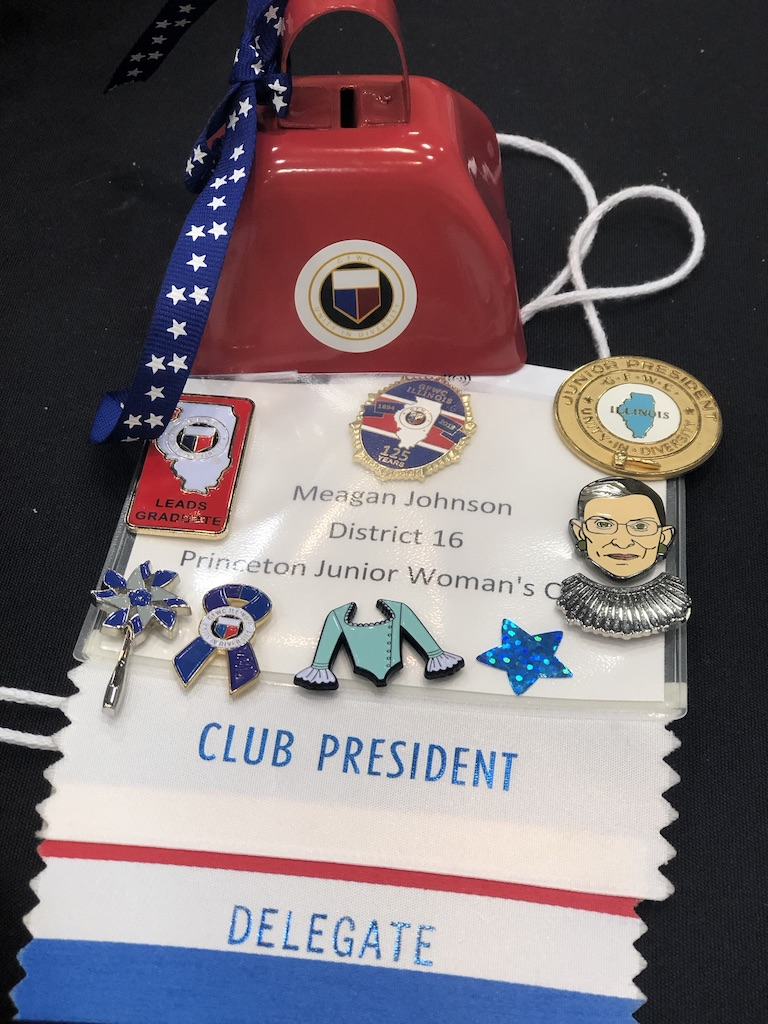 GFWC International members love pins. The cowbell is just one of many ways we cheer on our fellow club members during award ceremonies.