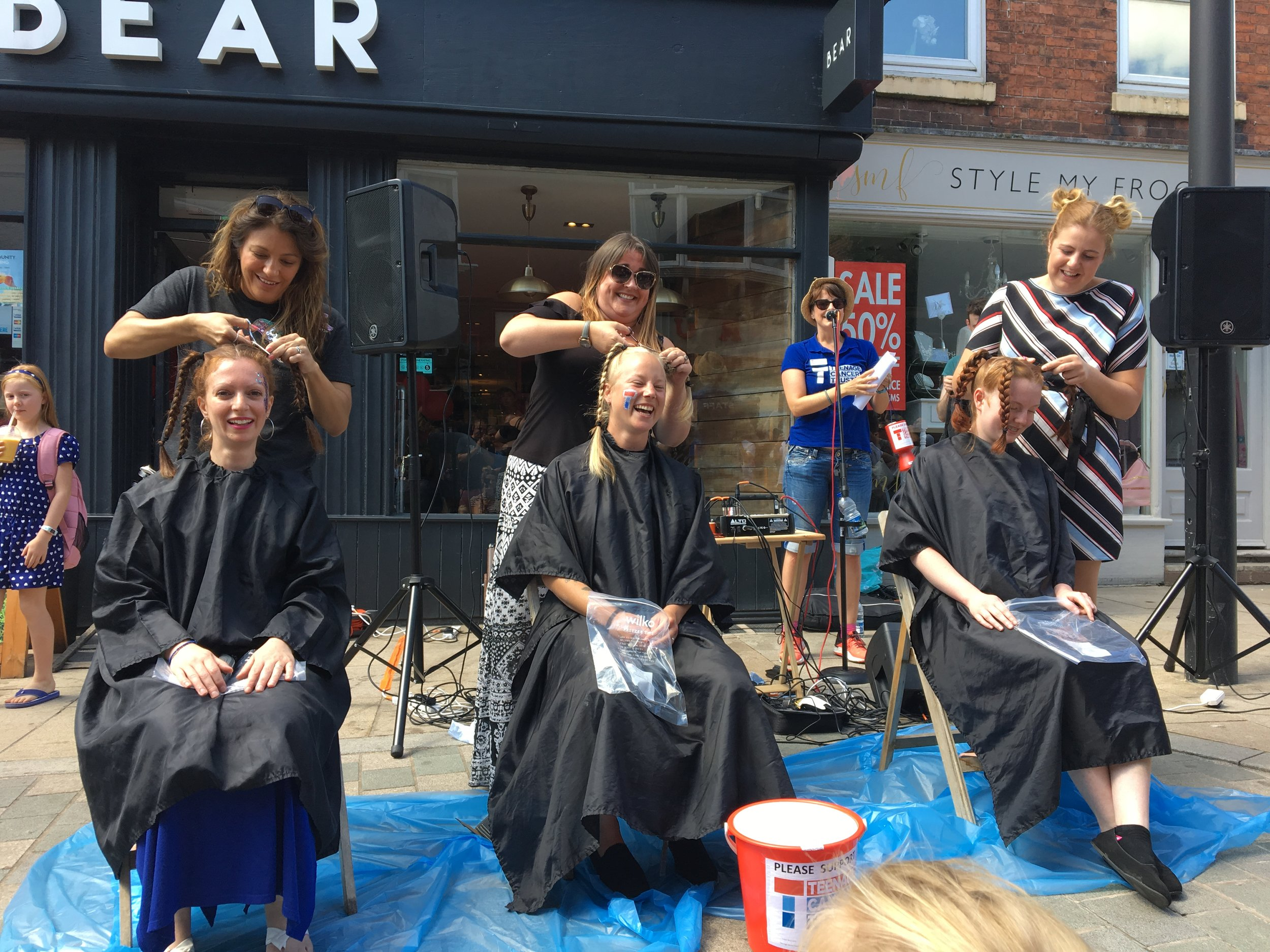 Ladies having their heads shaved for charity