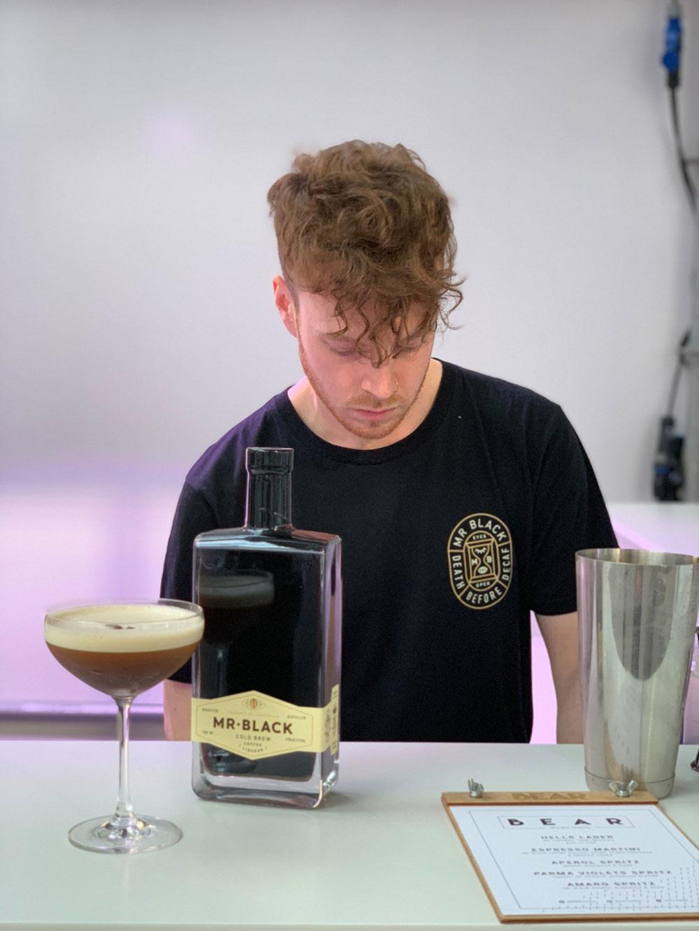 Alex making cocktails